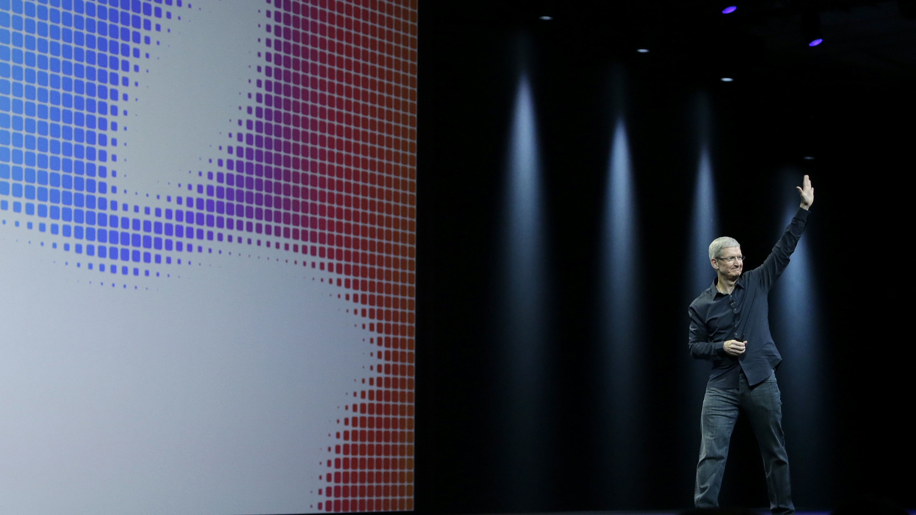 Apple CEO Tim Cook waves after speaking at an Apple Worldwide Developers Conference event in San Francisco, Monday, June 2, 2014. (AP Photo/Jeff Chiu)