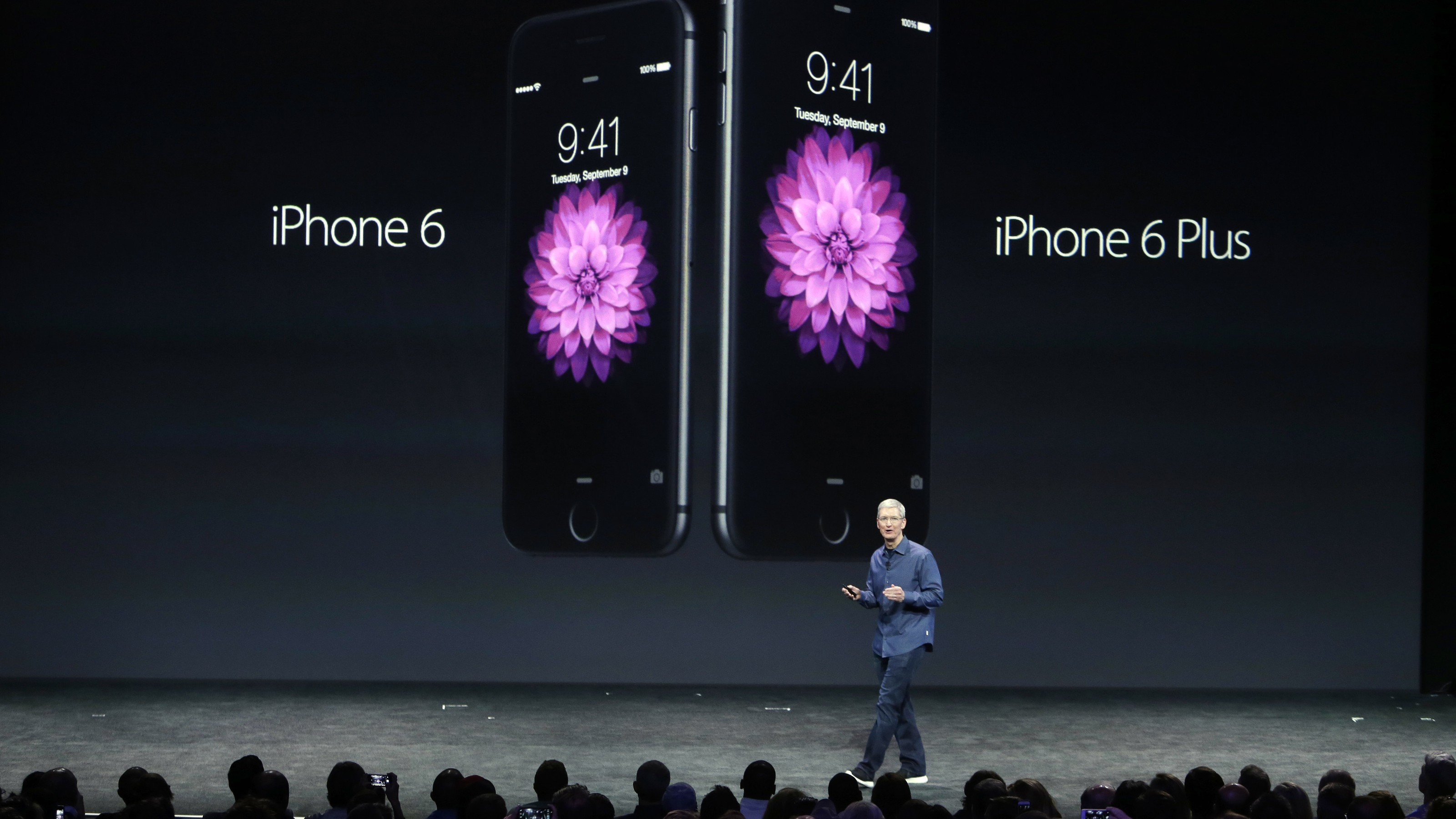 Apple CEO Tim Cook with the iPhone 6 and iPhone 6 Plus