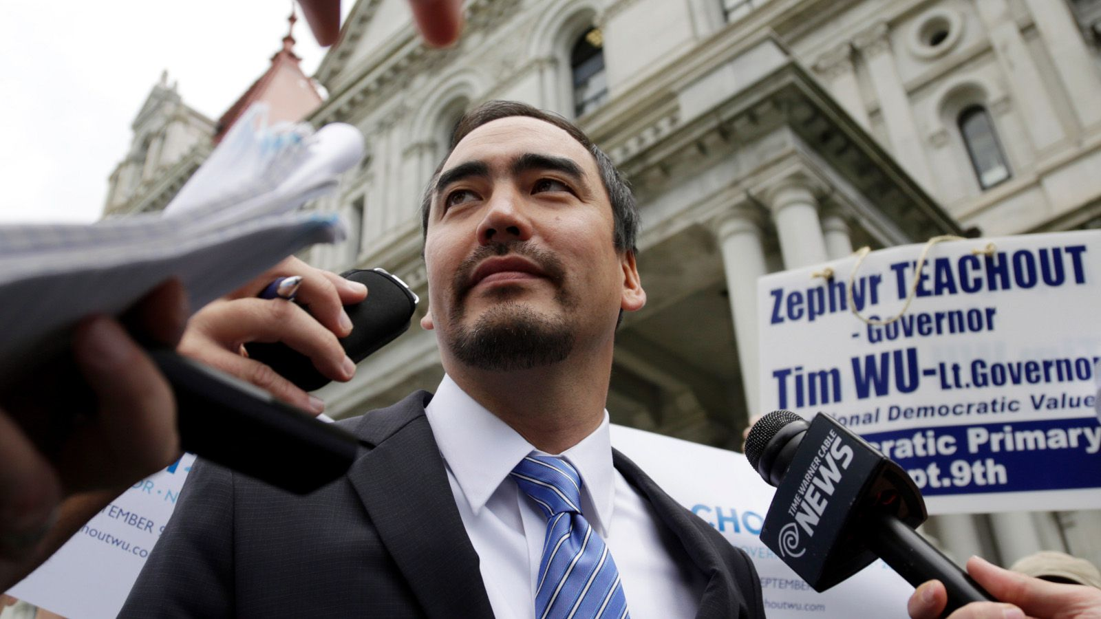 Tim Wu, a candidate for New York lieutenant governor, talks to reporters outside the state Capitol on Thursday, Aug. 28, 2014, in Albany, N.Y. The New York Times has endorsed Wu, who is running alongside liberal gubernatorial candidate Zephyr Teachout, over Gov. Andrew Cuomo's running mate Kathy Hochul.
