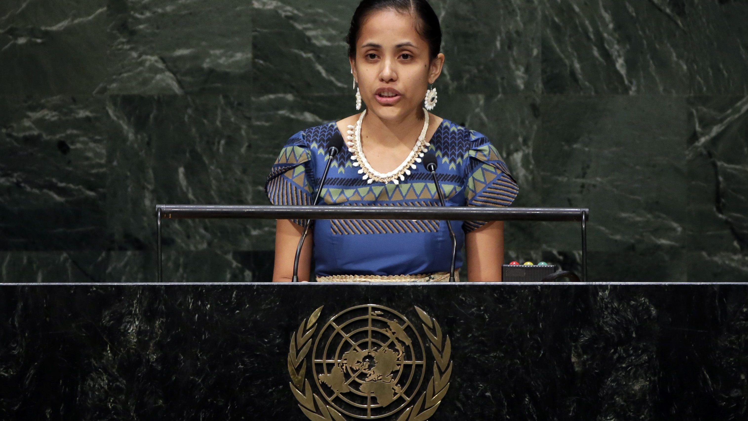 Kathy Jetnil-Kijiner, Civil Society Representative from the Marshall Islands, addresses the Climate Summit, at United Nations headquarters, Tuesday, Sept. 23, 2014. (AP Photo/Richard Drew)