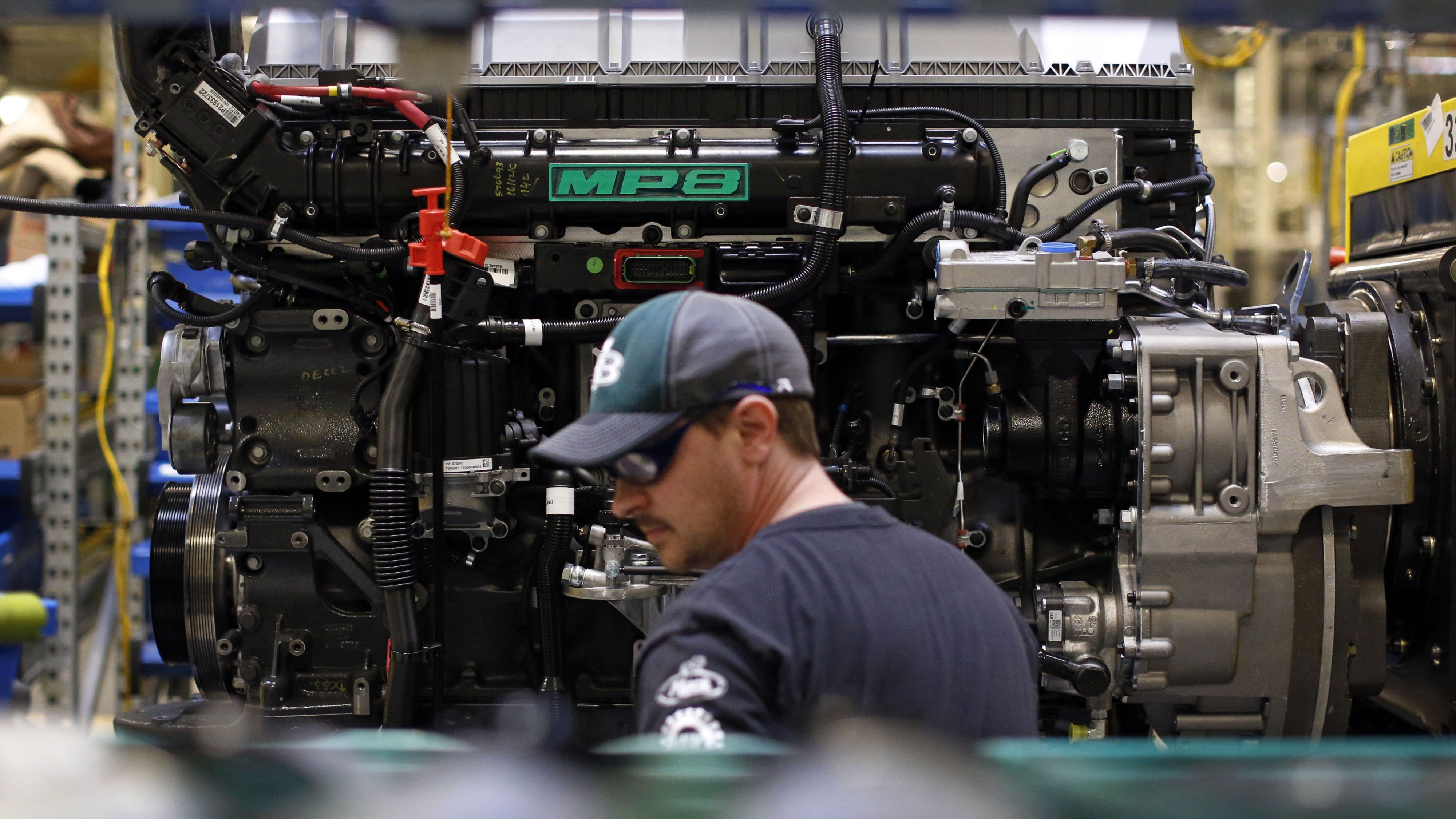 In this March 26, 2014 picture, Ed Carbaugh prepares to install parts on a truck engine on an assembly line at Volvo Trucks' powertrain manufacturing facility in Hagerstown, Md. The Federal Reserve reports on industrial production for April on Thursday, May 15, 2014. (AP Photo/Patrick Semansky)