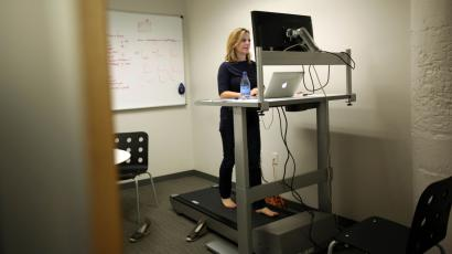 Woman at a treadmill desk