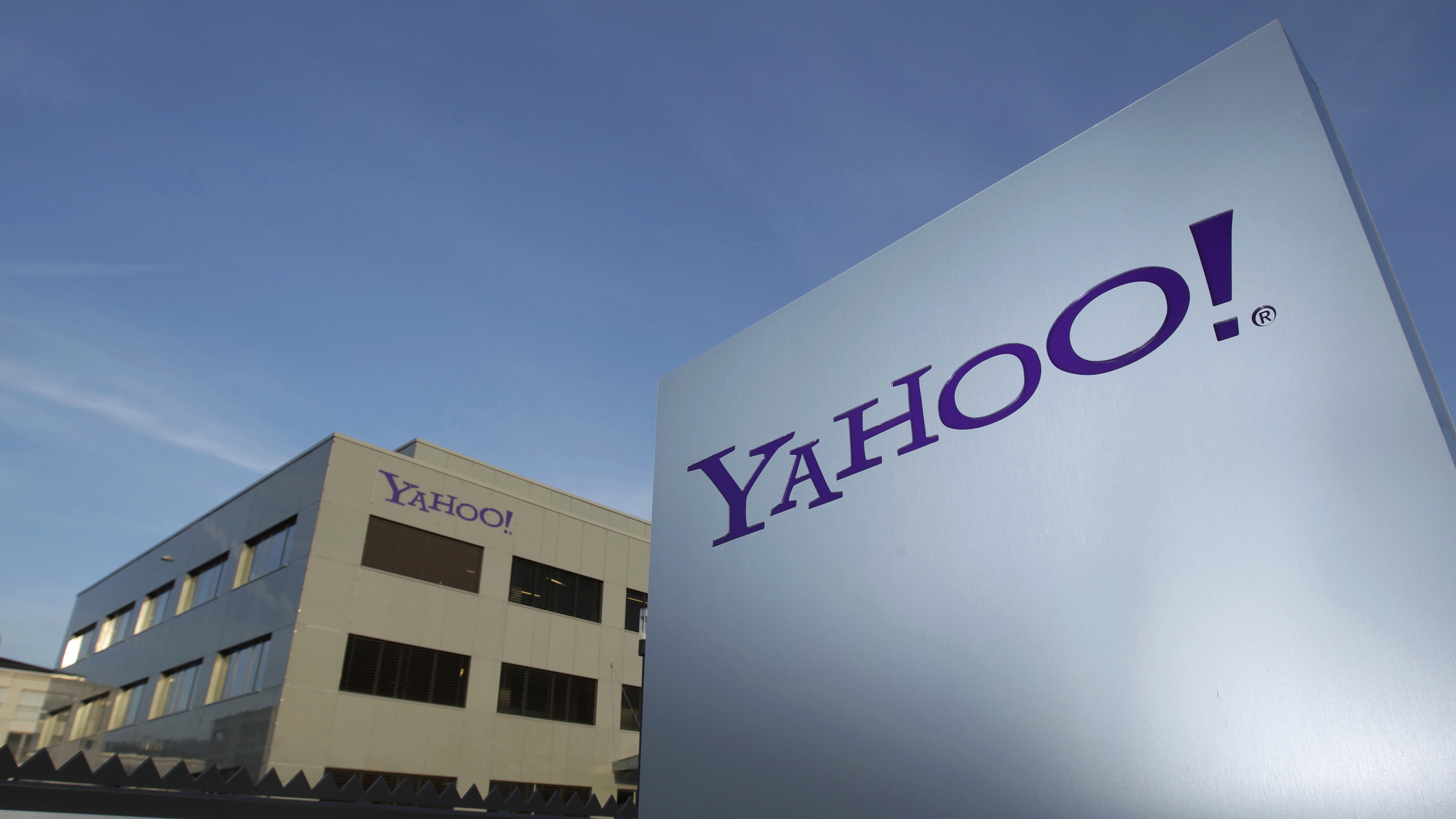 A Yahoo logo is pictured in front of a building in Rolle, 30 km (19 miles) east of Geneva, in this file picture taken December 12, 2012. Yahoo! Inc is shifting its main European tax base to Ireland from Switzerland, a Reuters examination of company statements and accounts shows, as pressure mounts on the Alpine nation to abolish some corporate tax incentives. Picture taken December 12, 2012.       REUTERS/Denis Balibouse (SWITZERLAND - Tags: BUSINESS POLITICS LOGO) - RTX18CHP