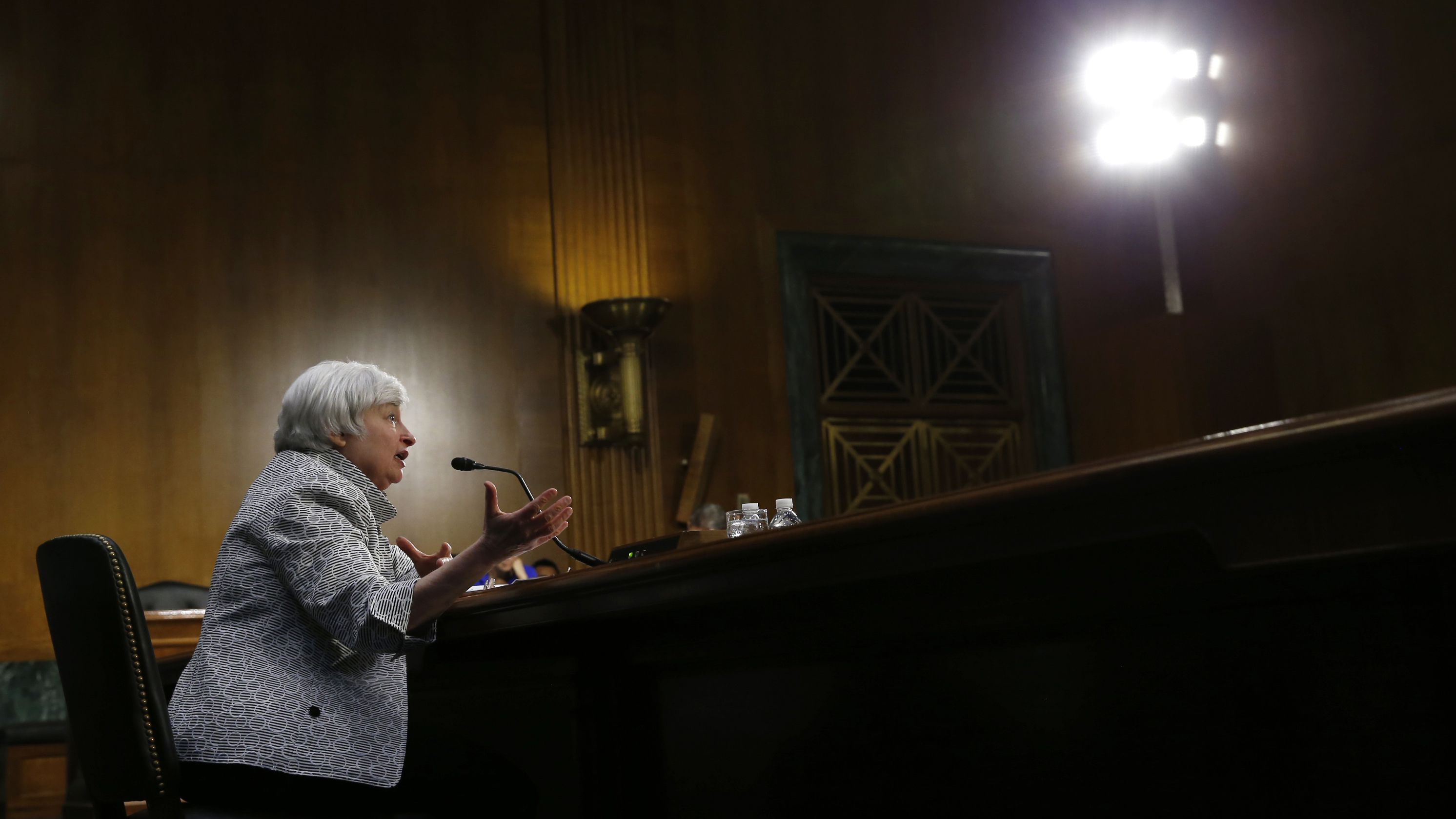 U.S. Federal Reserve Chair Janet Yellen testifies before the Senate Banking Committee on Capitol Hill in Washington July 15, 2014. The U.S. economic recovery remains incomplete, with a still-ailing job market and stagnant wages justifying loose monetary policy for the foreseeable future, Yellen told the Senate committee on Tuesday. REUTERS/Kevin Lamarque (UNITED STATES - Tags: POLITICS BUSINESS TPX IMAGES OF THE DAY)