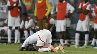 Burkina Faso players, including Mohamed Koffi, front, react as their African Cup of Nations final soccer match against Nigeria ends in defeat, at Soccer City Stadium in Johannesburg, South Africa, Sunday, Feb. 10, 2013. Nigeria defeated Burkina Faso 1-0. (AP Photo/Rebecca Blackwell)