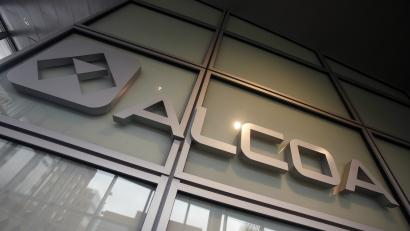 This April 7, 2014 photo shows the Alcoa logo in the lobby of Alcoa's headquarters in Pittsburgh. Company officials announced Thursday, May 29, 2014, that they will build a $100 million plant in La Porte, Ind., to make nickel-based engine parts for commercial airliners. Alcoa already makes the same components — in smaller sizes — for engines that go on business jets and planes flown by regional airlines. (AP Photo/Gene Puskar)