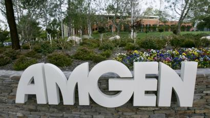 In this March 1, 2005 file photo, one of many buildings at Amgen's wooded, sprawling headquarters complex in Thousand Oaks, Calif., is shown. Amgen Inc. releases its quarterly earnings report after the market close Monday, Jan. 25, 2010.(AP Photo/Reed Saxon, File)