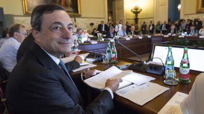 President of European Central Bank Mario Draghi sits at the table prior to the start of the ECB governing council meeting in Naples, Italy, Thursday, Oct. 2, 2014.