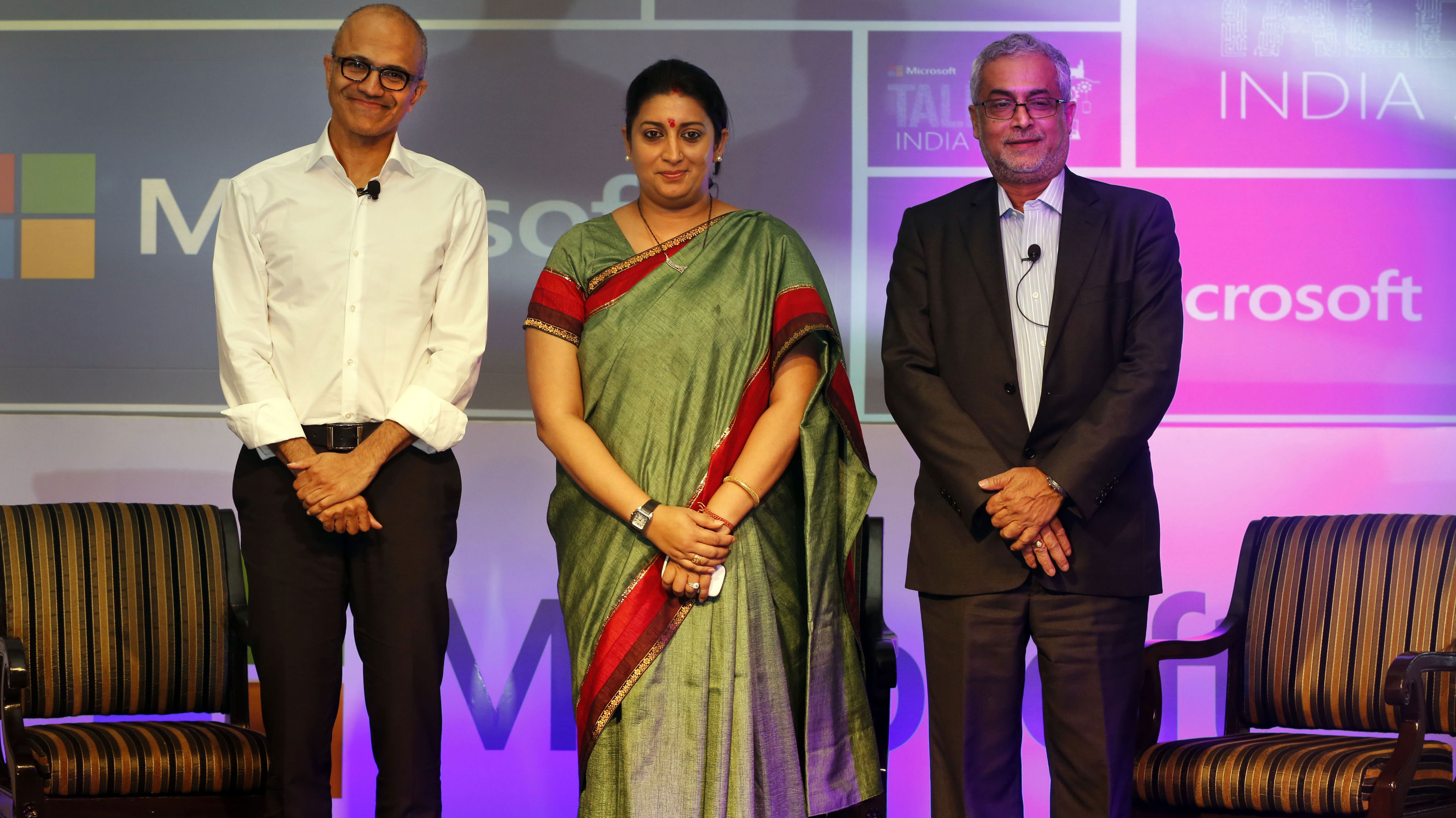From left, Chief Executive Officer of Microsoft Satya Nadella, Indian minister for Human Resource Development Smriti Irani and Chairman of Microsoft India Bhaskar Pramanik, pose for the media at the Talent India 2014 program in New Delhi, India, Tuesday, Sept. 30, 2014. (AP Photo/Manish Swarup)