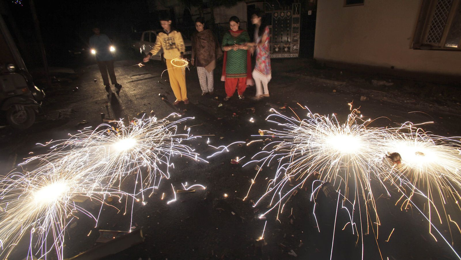 People let off fireworks to celebrate Diwali, the Hindu festival of lights, in Jammu India, Sunday, Nov. 3, 2013. Hindus across the country are celebrating Diwali where people decorate their homes with lights, let off fireworks and  pray to Lakshmi, the goddess of wealth. (AP Photo /Channi Anand)