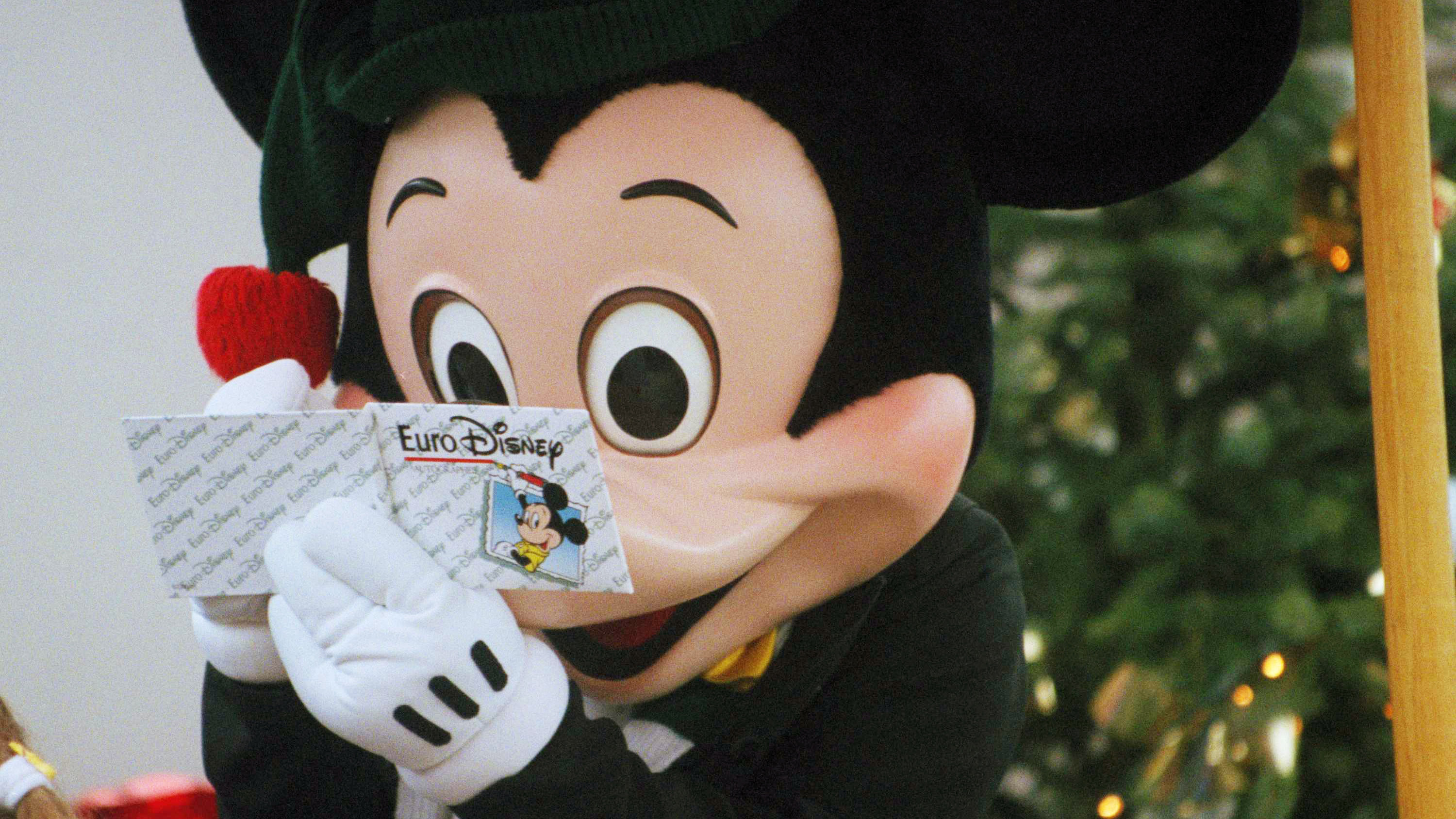 Mickey Mouse reads his schedule on a Euro Disney card during a photo opportunity at the Euro Disneyland theme park.