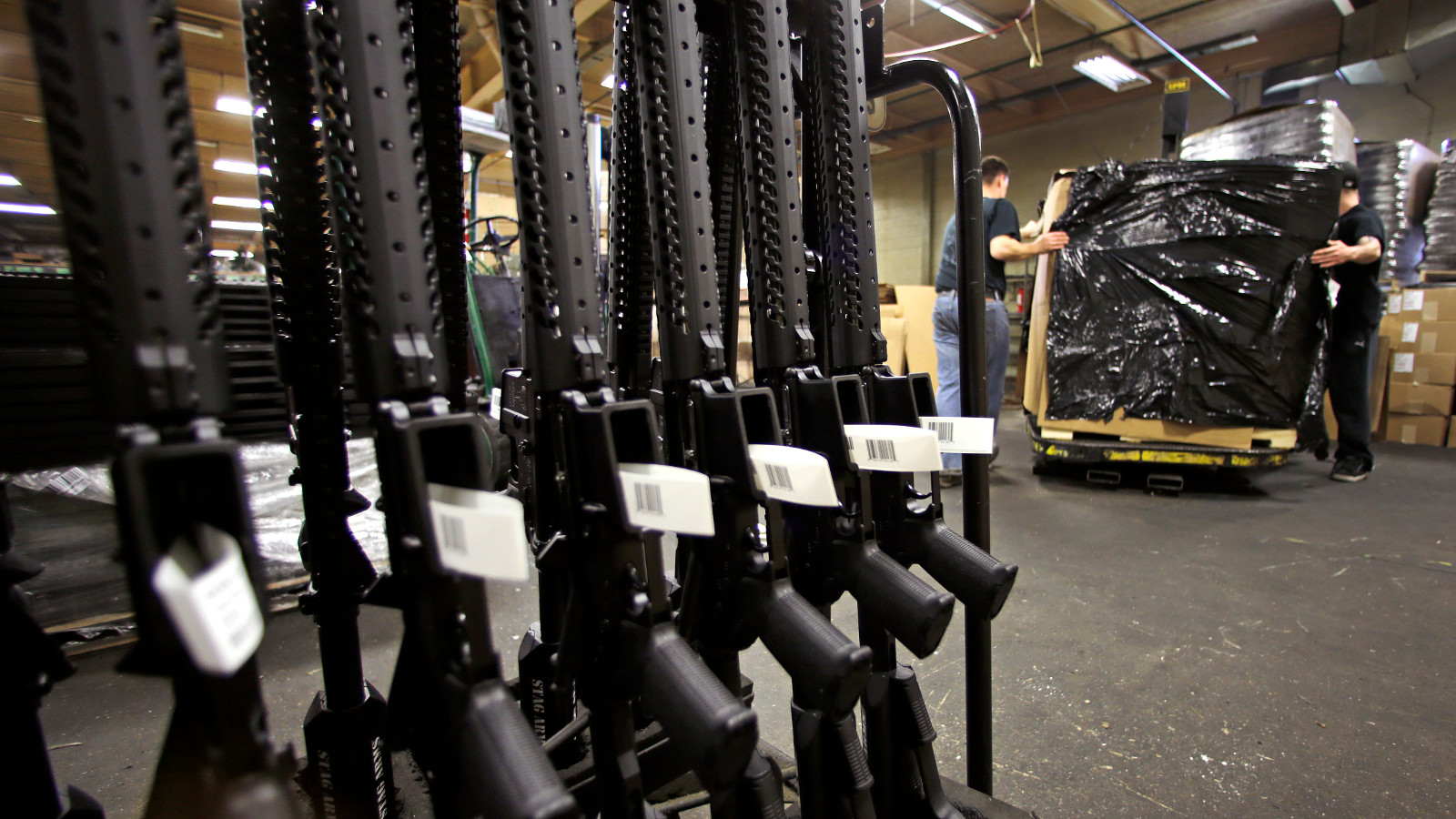 "A rack of AR-15 rifles stand to be individually packaged as workers move a pallet of rifles for shipment at the Stag Arms company in New Britain, Conn., Wednesday, April 10, 2013. A Connecticut gun-maker announced on Wednesday it intends to leave the state, just six days after passage of restrictive gun control legislation, while another manufacturer, Stag Arms, which employs about 230 workers, says its customers are urging it to ""pick up and leave."""