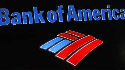 This photo taken Friday, Oct. 14, 2011, shows the Bank of America logo at a local branch office in Hialeah, Fla. Bank of America said Tuesday, Oct. 18, 2011, it earned $6.2 billion in the third-quarter largely from accounting gains and the sale of a stake in a Chinese bank. (AP Photo/Alan Diaz)