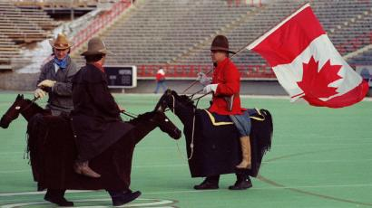 canada climate change global warming emissions November 27, 1993Participants in the annual Grey Cup parade, dressed as cowboys and a Mountie, chat with each other prior to the parade in Calgary November 27, 1993. The parade and opening ceremonies were being held on the eve of the 81st Grey Cup pitting the Edmonton Eskimos against the Winnipeg Blue Bombers. SCANNED FROM NEGATIVE REUTERS/Jeff Vinnick
