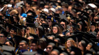 Students listen to President Barack Obama deliver the commencement address for the University of California, Irvine, Saturday, June 14, 2014, in Anaheim, Calif. (AP Photo/Mark J. Terrill)