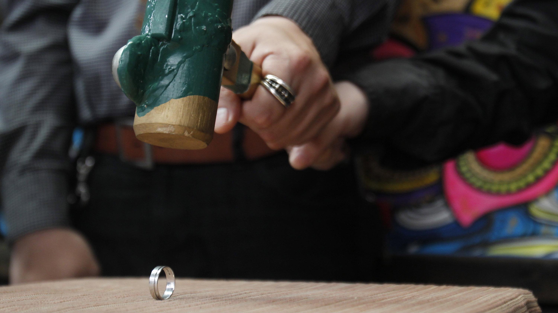 Couple smashing wedding ring