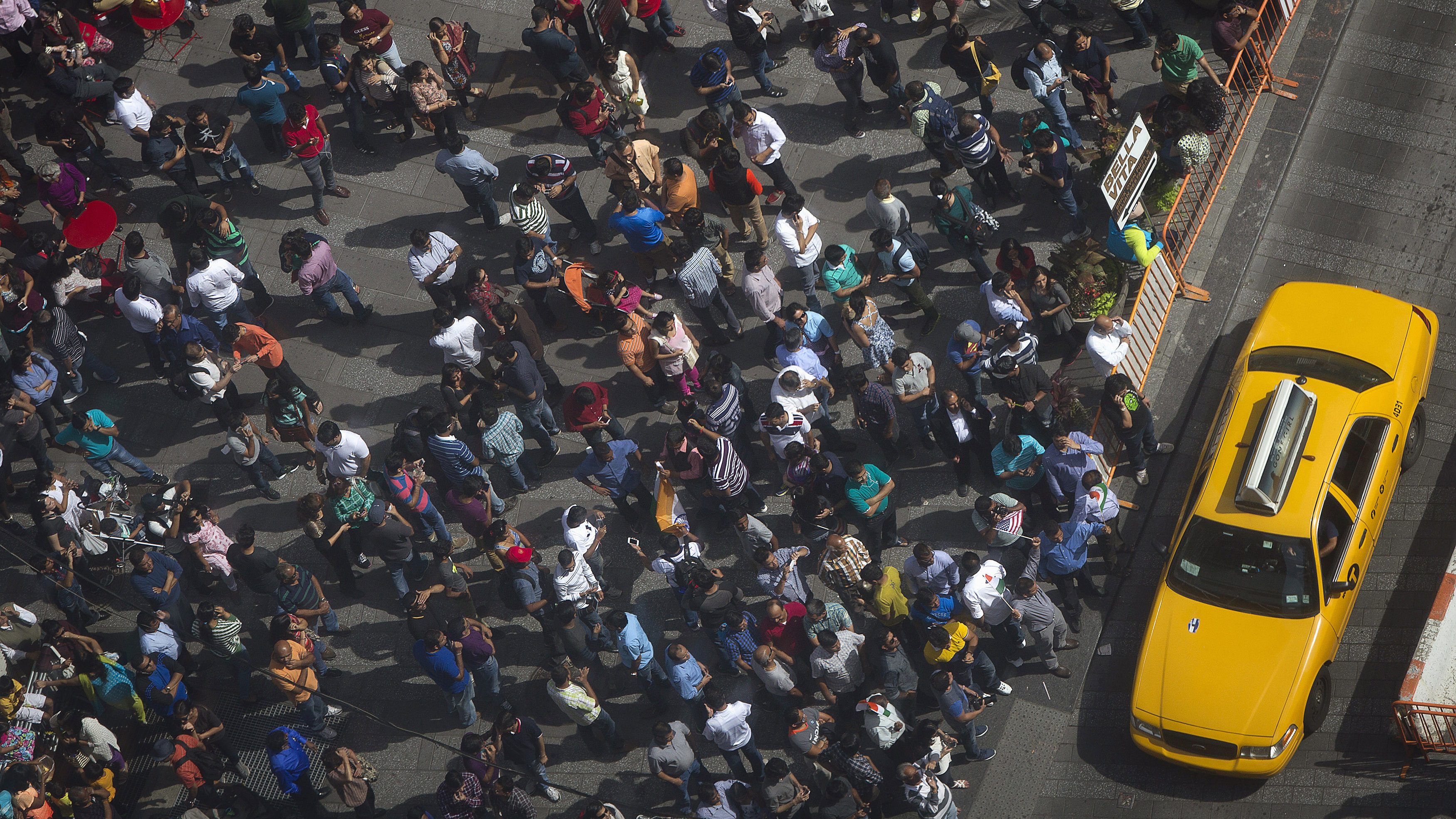 Supporters gather with a large crowd of people in Times Square to watch the speech by India's Prime Minister Narendra Modi simulcast on a giant screen in New York September 28, 2014.