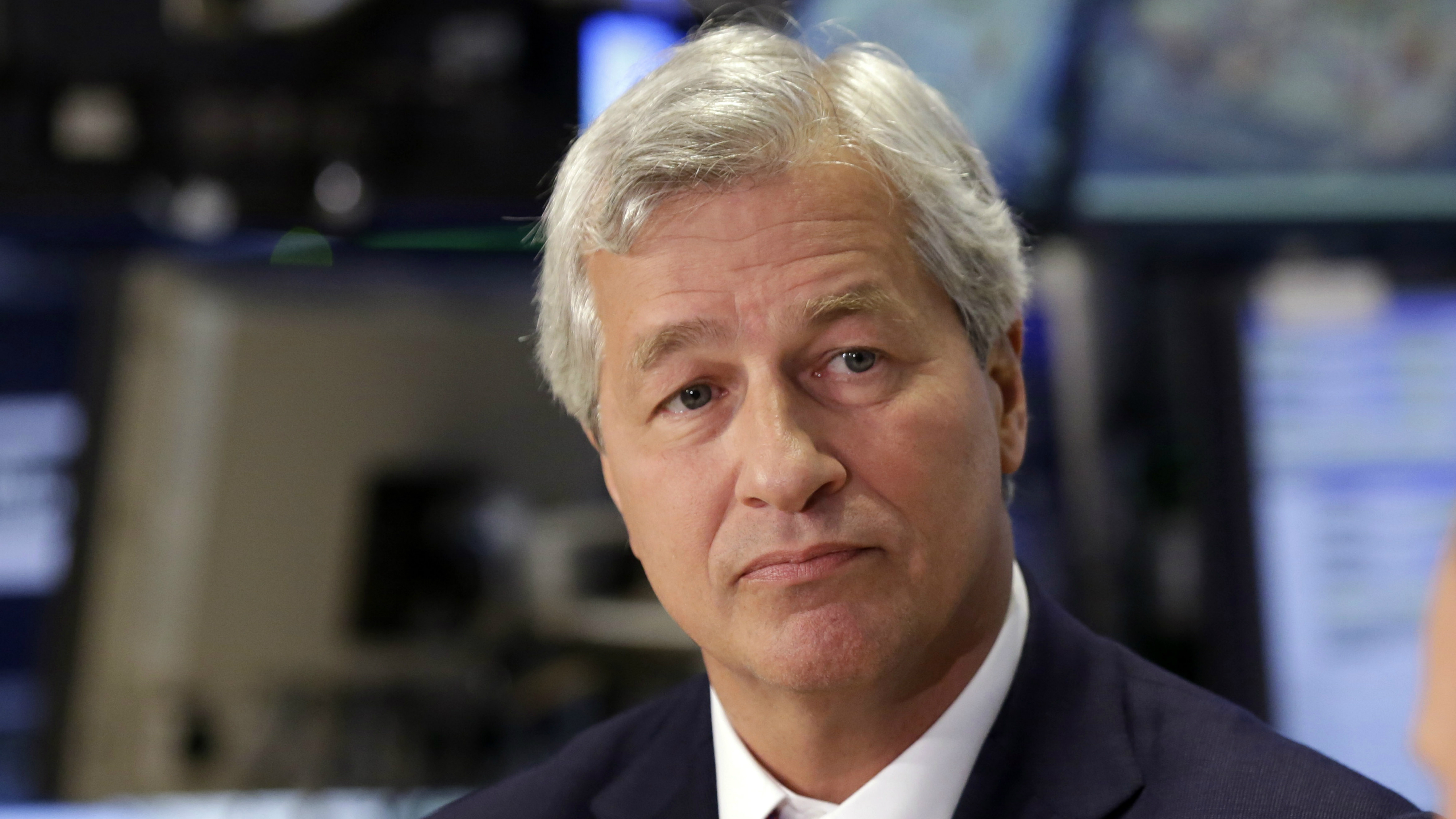 JPMorgan Chase Chairman and CEO Jamie Dimon is interviewed on the floor of the New York Stock Exchange Friday, July 12, 2013. (AP Photo/Richard Drew)