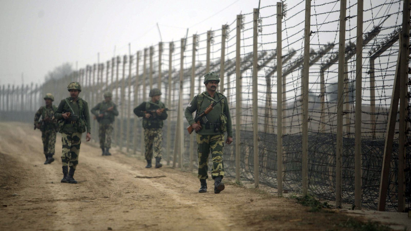 India's Border Security Force (BSF) soldiers patrol near the fenced border with Pakistan in Suchetgarh, southwest of Jammu, January 12, 2010. An Indian soldier was killed on Monday in cross-border firing in Kashmir, the latest in a spurt of violence in the disputed region that has raised tensions with Pakistan, officials said.