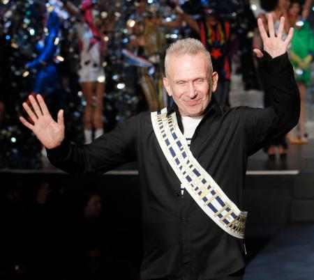 French designer Jean Paul Gaultier reacts as he appears at the end of his Spring/Summer 2015 women's ready-to-wear collection during Paris Fashion Week September 27, 2014. Gaultier, the theatrical star designer of the French fashion world, presented his last women's ready-to-wear show today. The brand, owned by Spanish perfumer Puig, announced earlier this month that it will from now on focus its efforts on haute couture, perfume, and industry collaborations. REUTERS/Gonzalo Fuentes (FRANCE - Tags: FASHION PROFILE ENTERTAINMENT SOCIETY TPX IMAGES OF THE DAY) - RTR47YU3