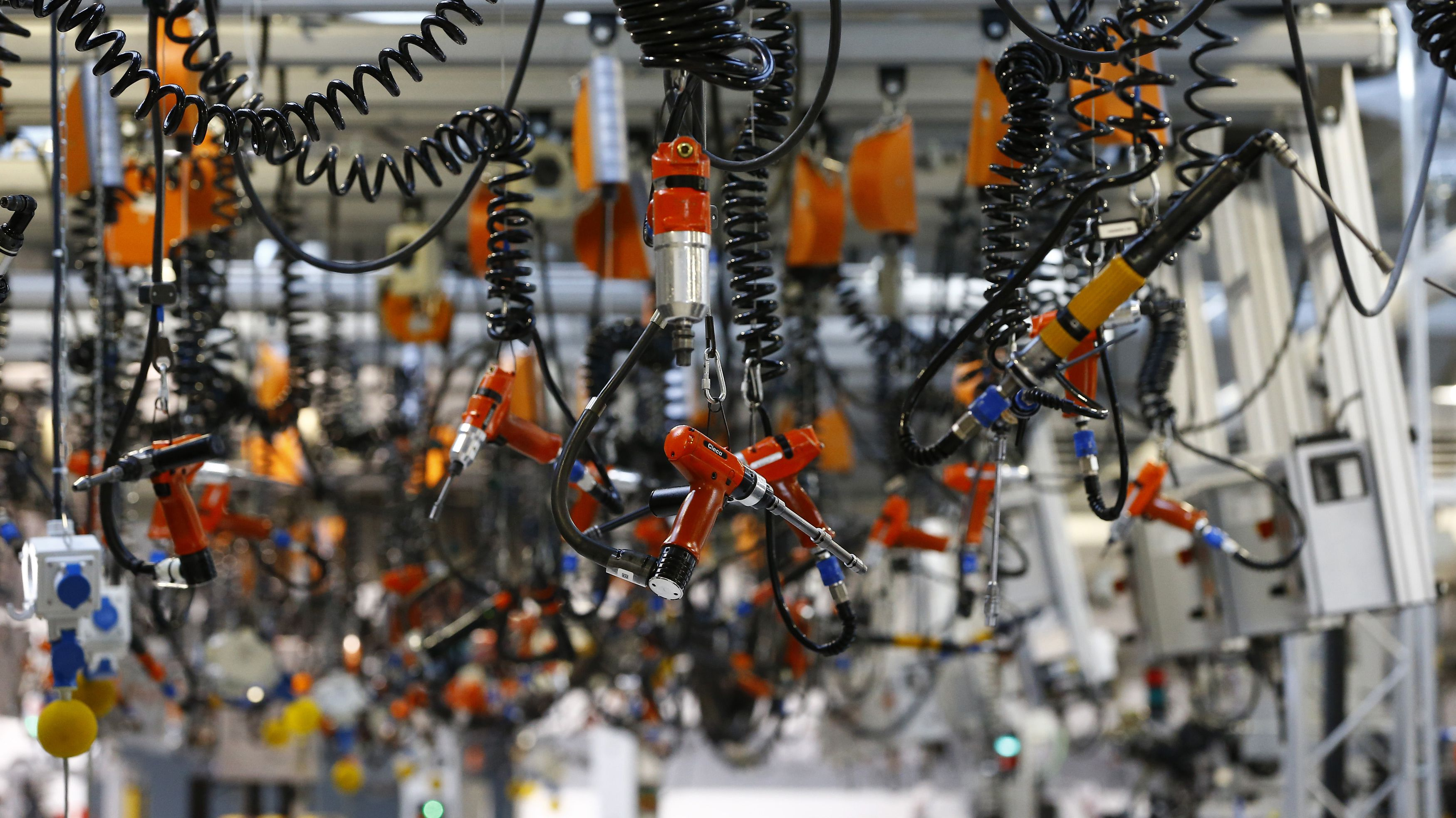 Various tools are seen hanging from the ceiling at the engine manufacturing unit for the new Mercedes AMG GT super sports cars during a factory tour for journalists at the Mercedes AMG headquarters in Affalterbach near Stuttgart, September 9, 2014. According to AMG, each engine for the new sports car will be manufactured by hand from a worker, with his personalized name plate on it. The new Mercedes AMG GT, from German car manufacturer Mercedes' sports car unit AMG, will be unveiled during a World Premier party on September 9. REUTERS/Kai Pfaffenbach (GERMANY - Tags: TRANSPORT BUSINESS EMPLOYMENT SPORT MOTORSPORT)