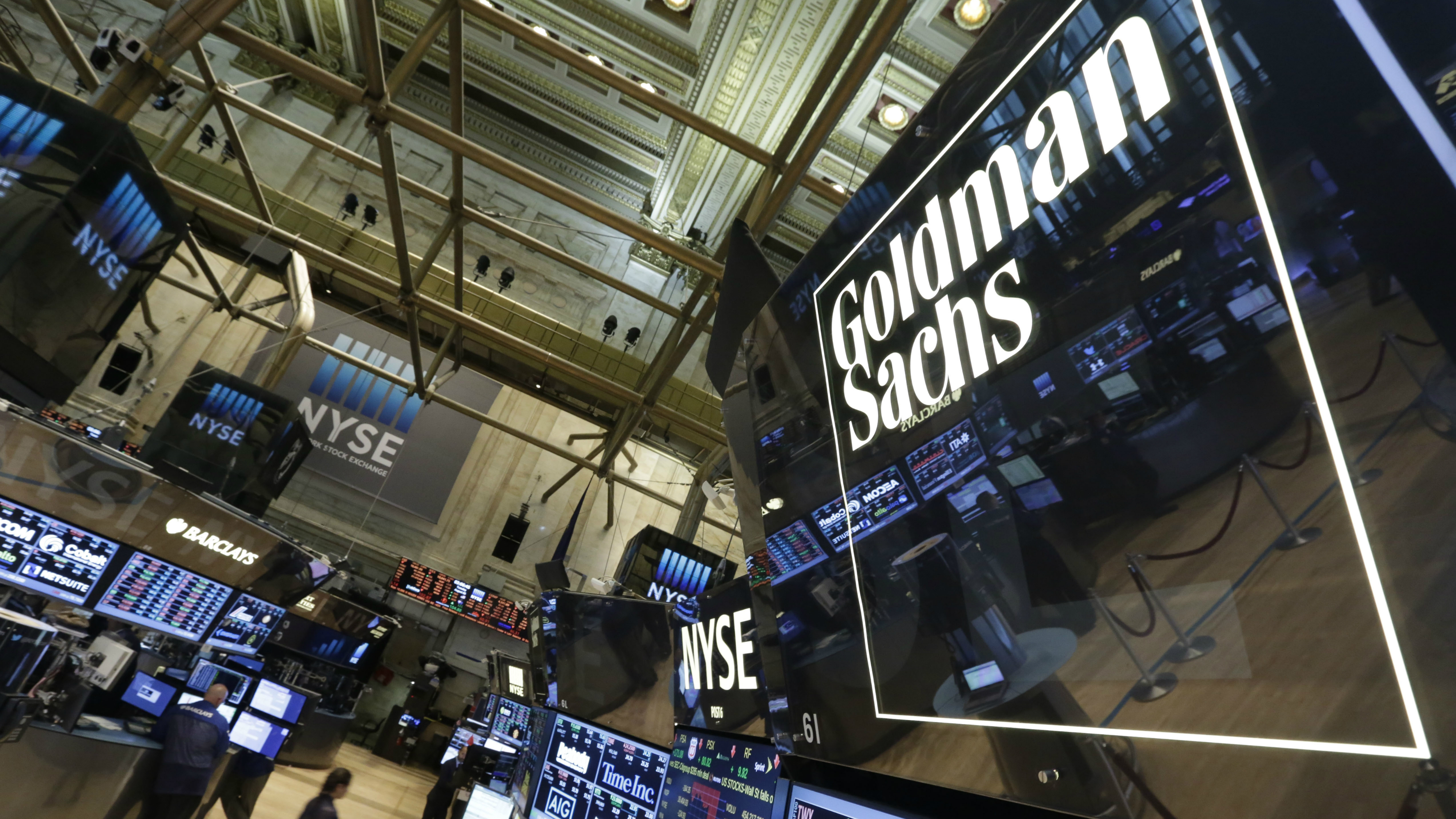 A lighted sign marks the Goldman Sachs trading post on the floor of the New York Stock Exchange, Tuesday, Aug. 5, 2014. The designated market maker operations of Goldman Sachs were sold to Dutch company IMC Financial Markets, which is scheduled to rebrand the post next week. (AP Photo/Richard Drew)