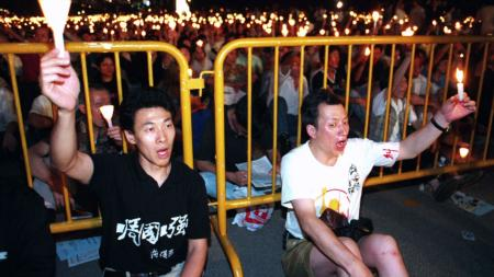 Han Dongfang (left) at a candle light vigil in Hong Kong on June 4, 1996 for the anniversary of the Tiananmen Massacre.