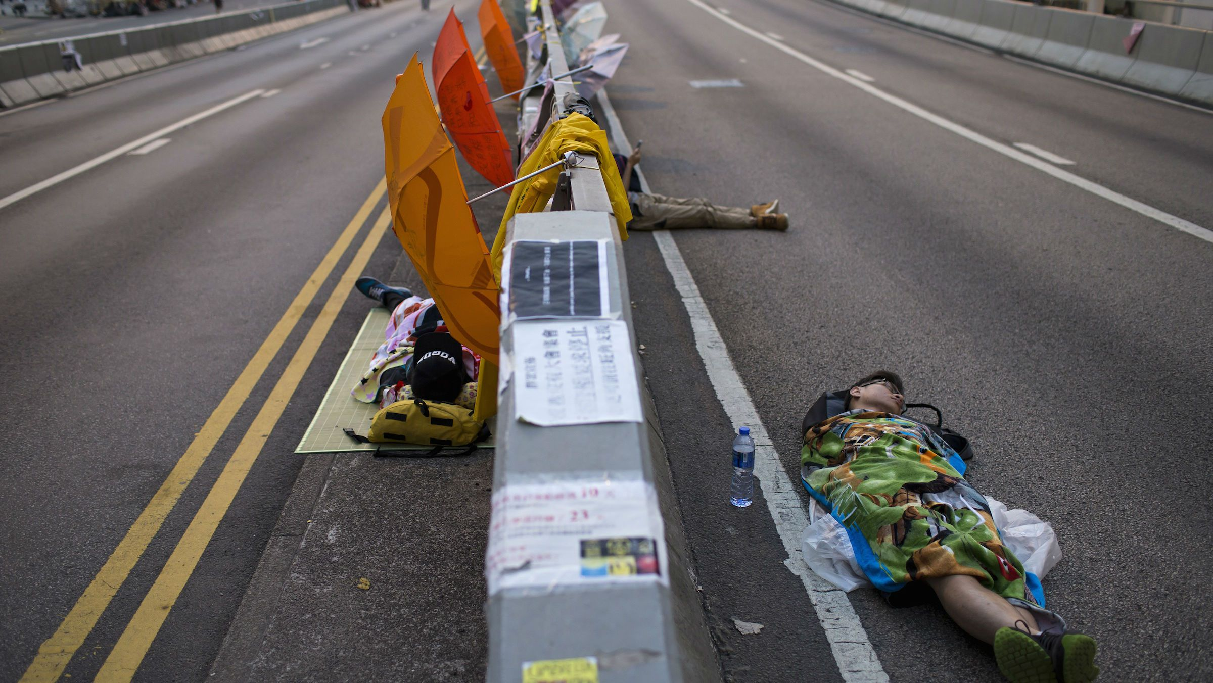 2014Protesters of the Occupy Central movement sleep on a main road leading to the financial Central district being blocked at dawn,