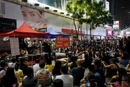 "A ""mobile democracy classroom"" lecture is held as protesters occupy a main road for the third day at Causeway Bay shopping district in Hong Kong October 1, 2014."
