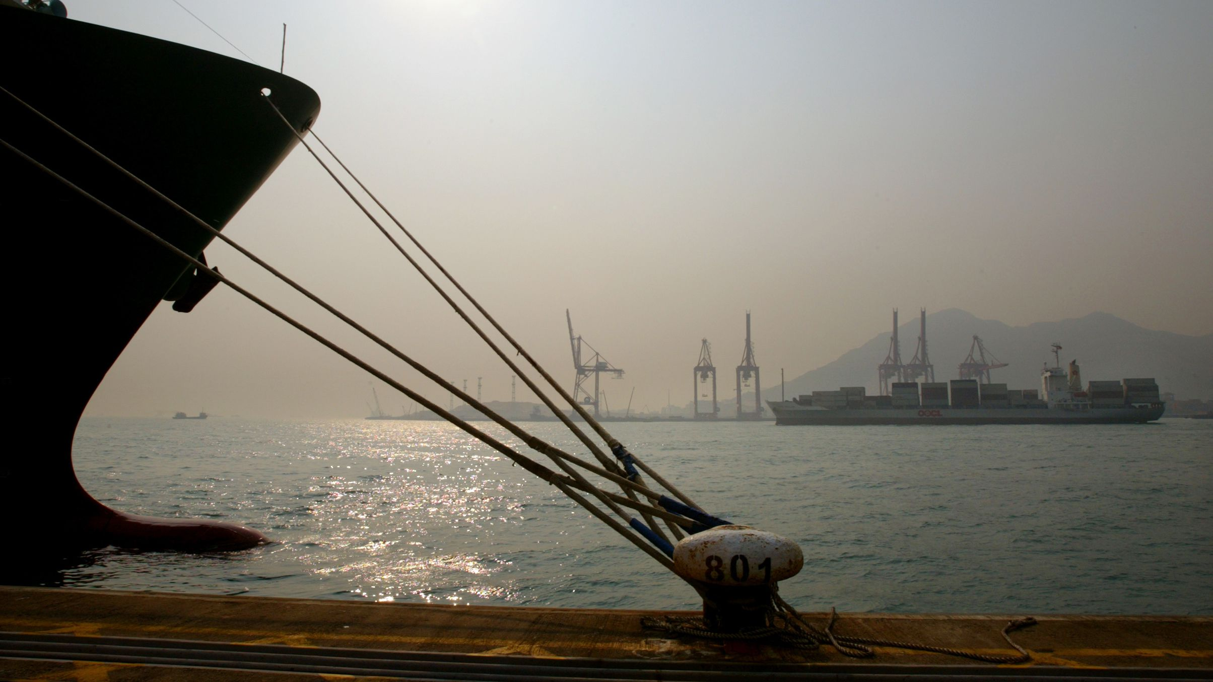 Containers are loaded onto a ship at Hong Kong's container terminal February 13, 2004. Hong Kong market sources said the Chinese government could delay container port development in Shenzhen, China, to avoid putting too much pressure on the world's busiest container port of Hong Kong, which has been losing market share to the cheaper Shenzhen port. NO RIGHTS CLEARANCES OR PERMISSIONS ARE REQUIRED FOR THIS IMAGE REUTERS/Kin Cheung KC/fa