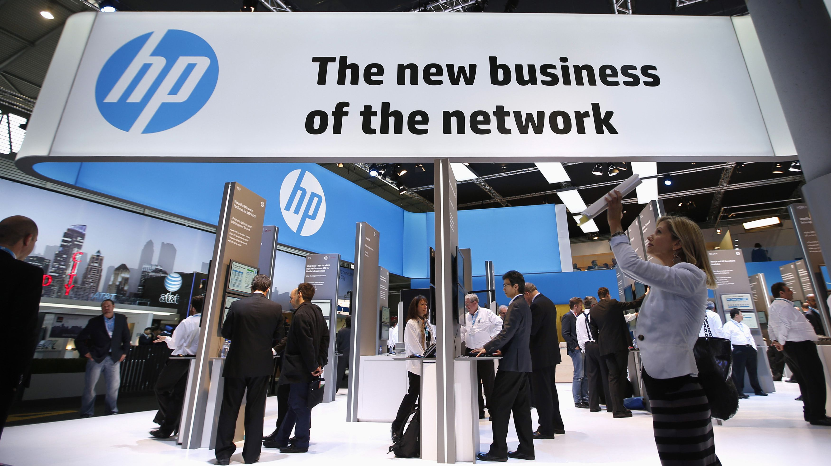 A visitor takes a photo with a tablet in front of a Hewlett-Packard (HP) stand at the Mobile World Congress in Barcelona, February 27, 2014. REUTERS/Albert Gea (SPAIN - Tags: BUSINESS TELECOMS SCIENCE TECHNOLOGY) - RTR3FSN7
