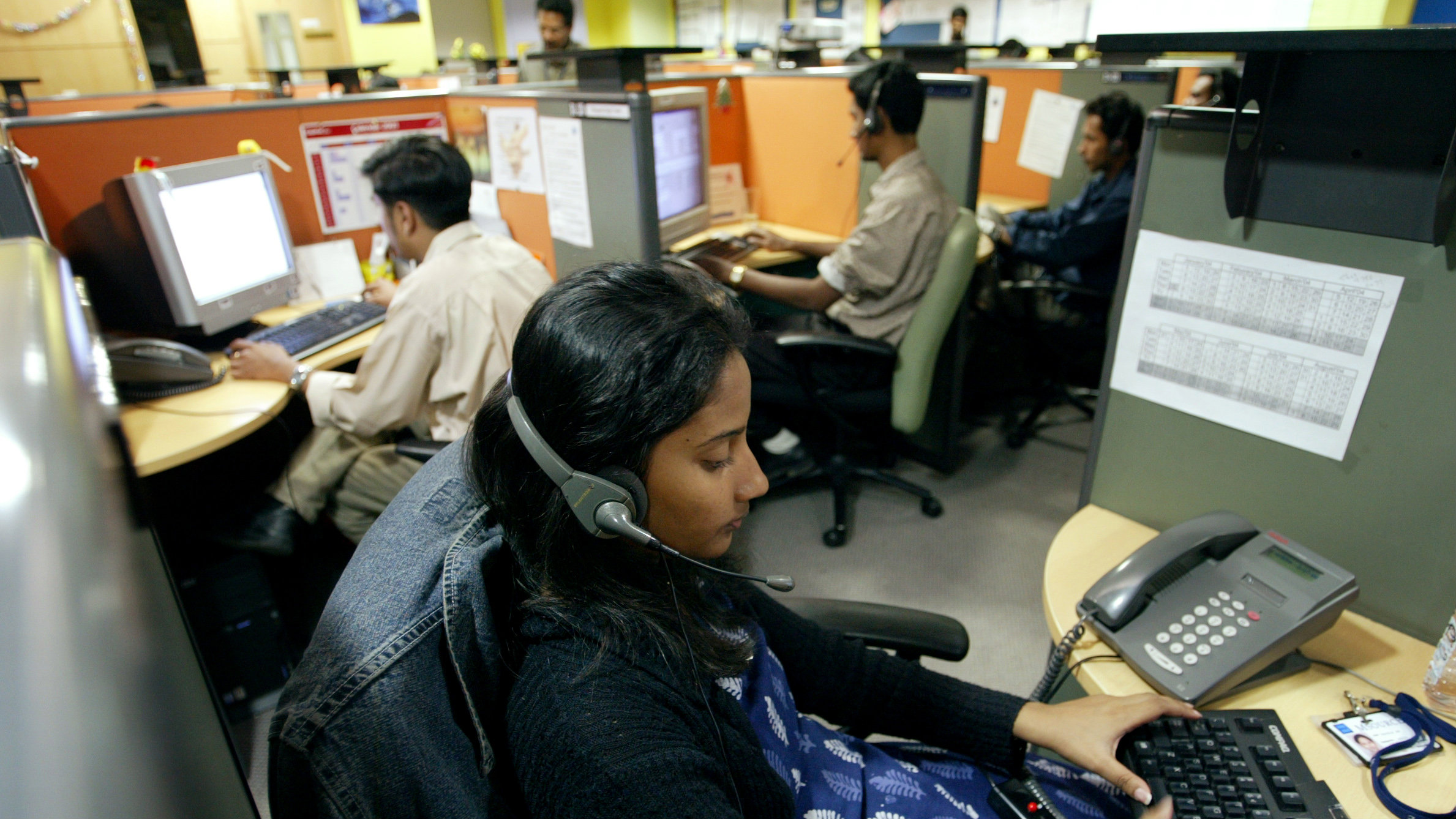 Indian employees at a call centre provide service support to international customers, in the southern city of Bangalore March 17, 2004. The hiring frenzy at call centres in India is the flip side of daily tales pouring out of the US and Britain, where thousands of software and back-office jobs are being cut as companies take advantage of cheap communications offshore to drive down costs. India is the undisputed leader of emerging markets to which developed economies are outsourcing high-technology jobs, IT consultancy firm Gartner said in a report released on Wednesday. The $3.6 billion industry in India is seen rocketing to 13.8 billion by 2007 with the number of jobs quadrupling to 1 million.