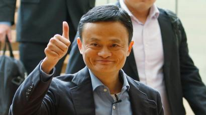 Alibaba founder Jack Ma gives a thumbs-up as he arrives to speak to investors at an initial public offering roadshow in Singapore September 16, 2014. Alibaba Group Holding Ltd raised the price range on its initial public offering to $66 to $68 on Monday, reflecting strong demand from investors for the year's most anticipated debut and potentially the world's largest-ever IPO. The Chinese e-commerce company, which handles more transactions than Amazon.com Inc and eBay Inc combined, has attracted investors keen to buy into the country's rapid growth and its evolving Internet sector. REUTERS/Edgar Su (SINGAPORE - Tags: BUSINESS SCIENCE TECHNOLOGY) - RTR46D5G