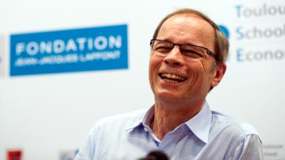 French economist Jean Tirole reacts as he speaks during a news conference at the Toulouse School of Economics in Toulouse October 13, 2014. French economist Jean Tirole won the 2014 economics Nobel Prize for his analysis of market power and regulation, the Royal Swedish Academy of Sciences said on Monday.