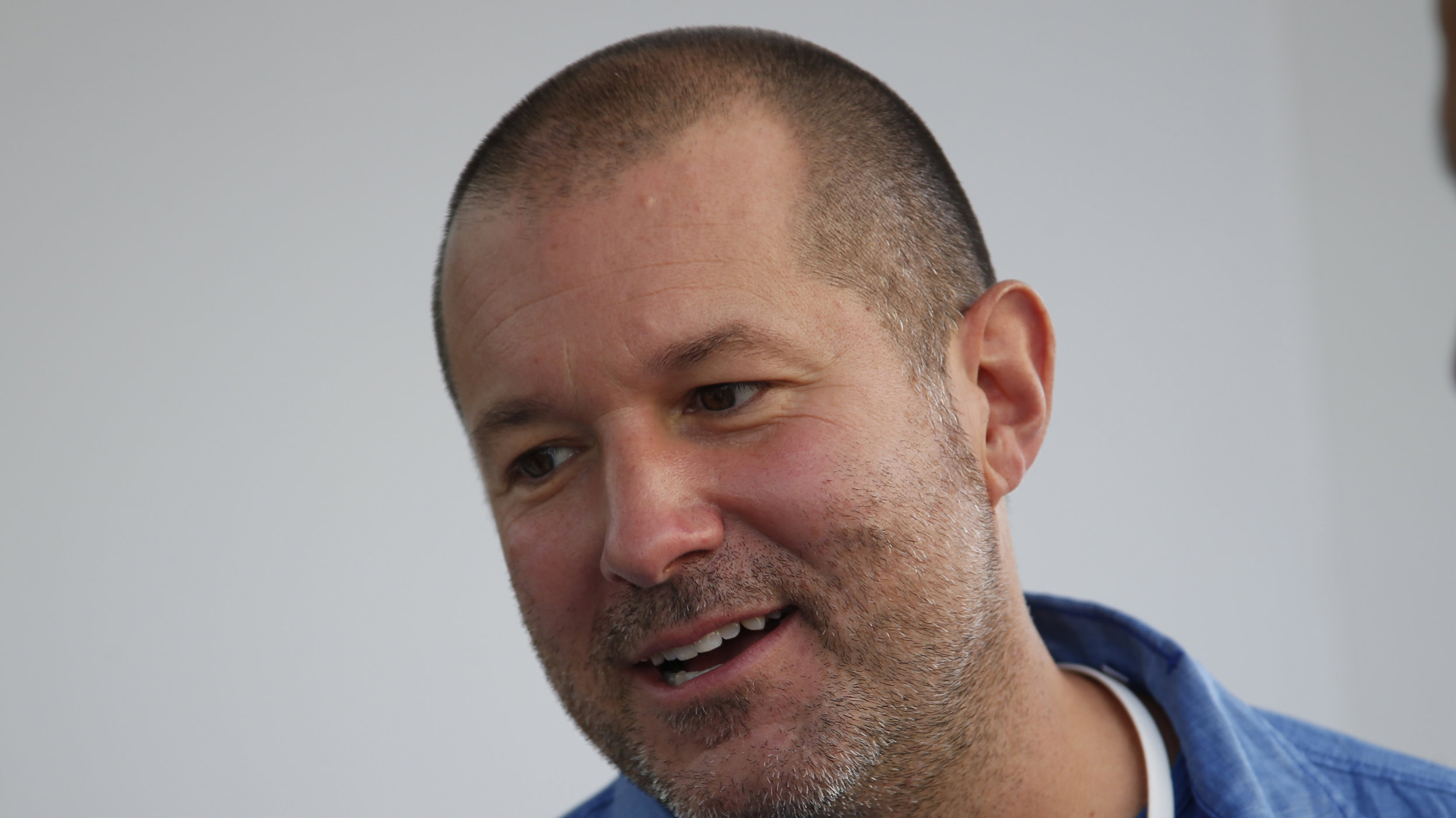 Jonathan Ive, Senior Vice President of Design at Apple Inc. speaks to members of the media during an Apple event announcing the iPhone 6 and the Apple Watch at the Flint Center in Cupertino, California, September 9, 2014. REUTERS/Stephen Lam