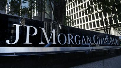 The JPMorgan Chase & Co. logo is displayed at their headquarters in New York, Monday, Oct. 21, 2013. JPMorgan Chase & Co. has tentatively agreed to pay $13 billion to settle allegations surrounding the quality of mortgage-backed securities it sold in the run-up to the 2008 financial crisis, a person familiar with the negotiations between the bank and the federal government said Saturday. (AP Photo/Seth Wenig)