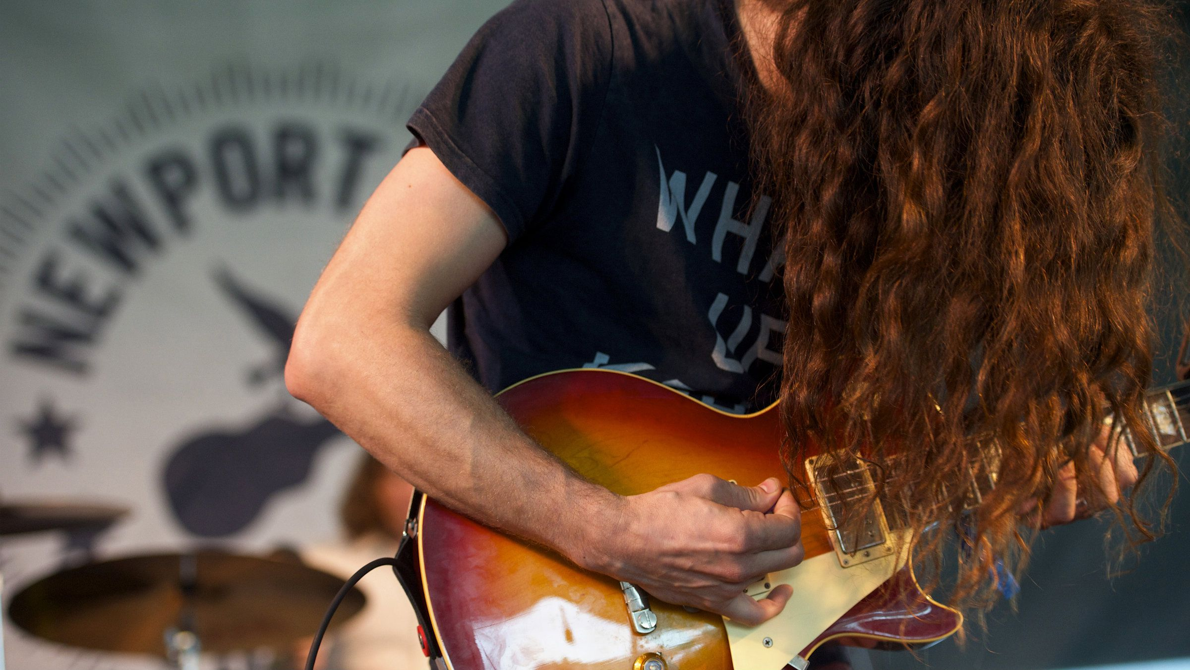 Singer Kurt Vile and his backing band The Violators (unseen) perform during the Newport Folk Festival in Rhode Island
