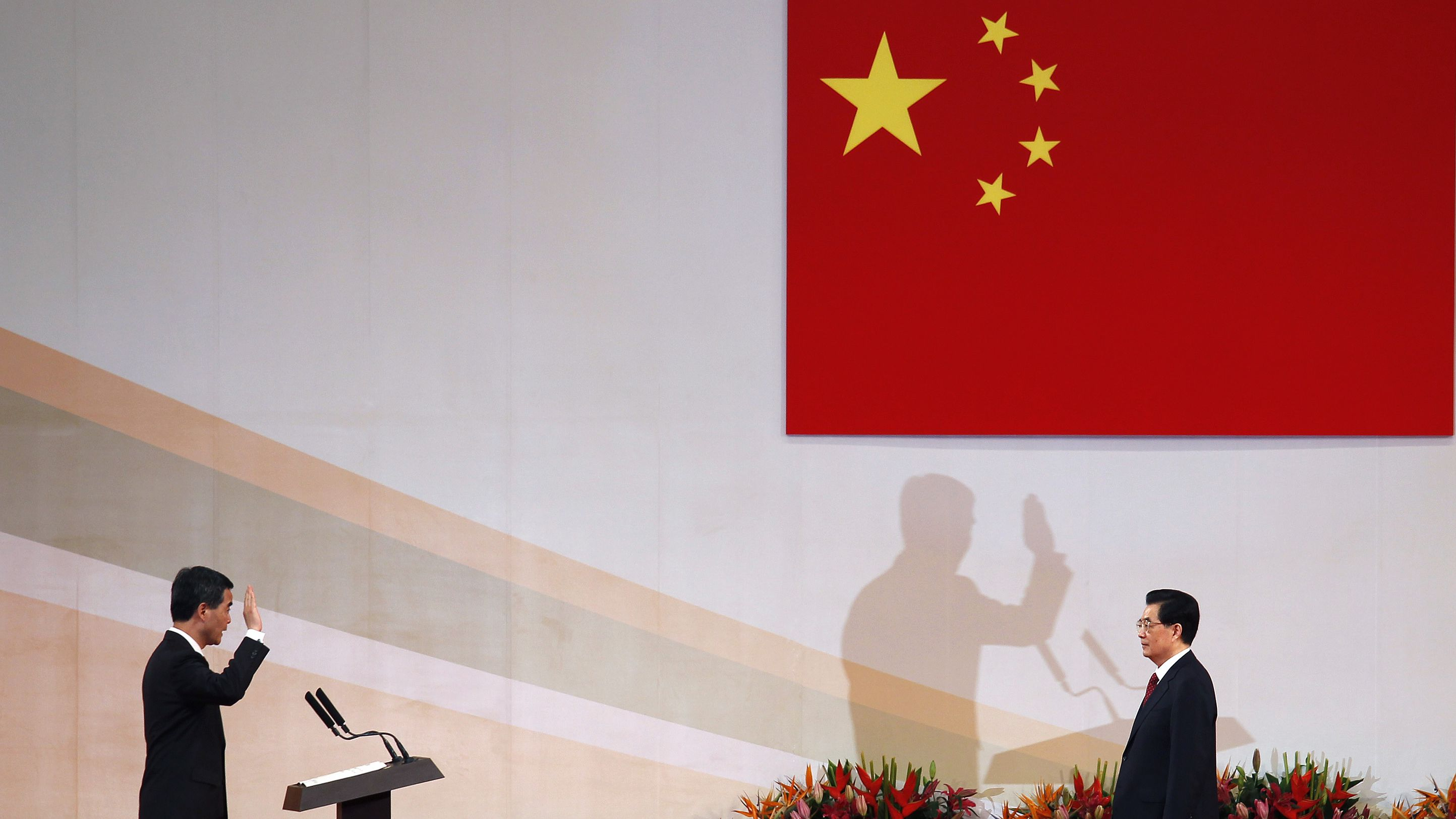 Hong Kong Chief Executive Leung Chun-ying (L) takes oath in front of Chinese President Hu Jintao during the inauguration of the new government in Hong Kong July 1, 2012, the day marking the 15th anniversary of the territory's handover to Chinese sovereignty from British rule. New Hong Kong leader Leung was sworn into office on Sunday by Chinese President Hu for a five-year term in which he will confront challenges ranging from human rights to democracy after a tumultuous year of transition and protest. REUTERS/Bobby Yip