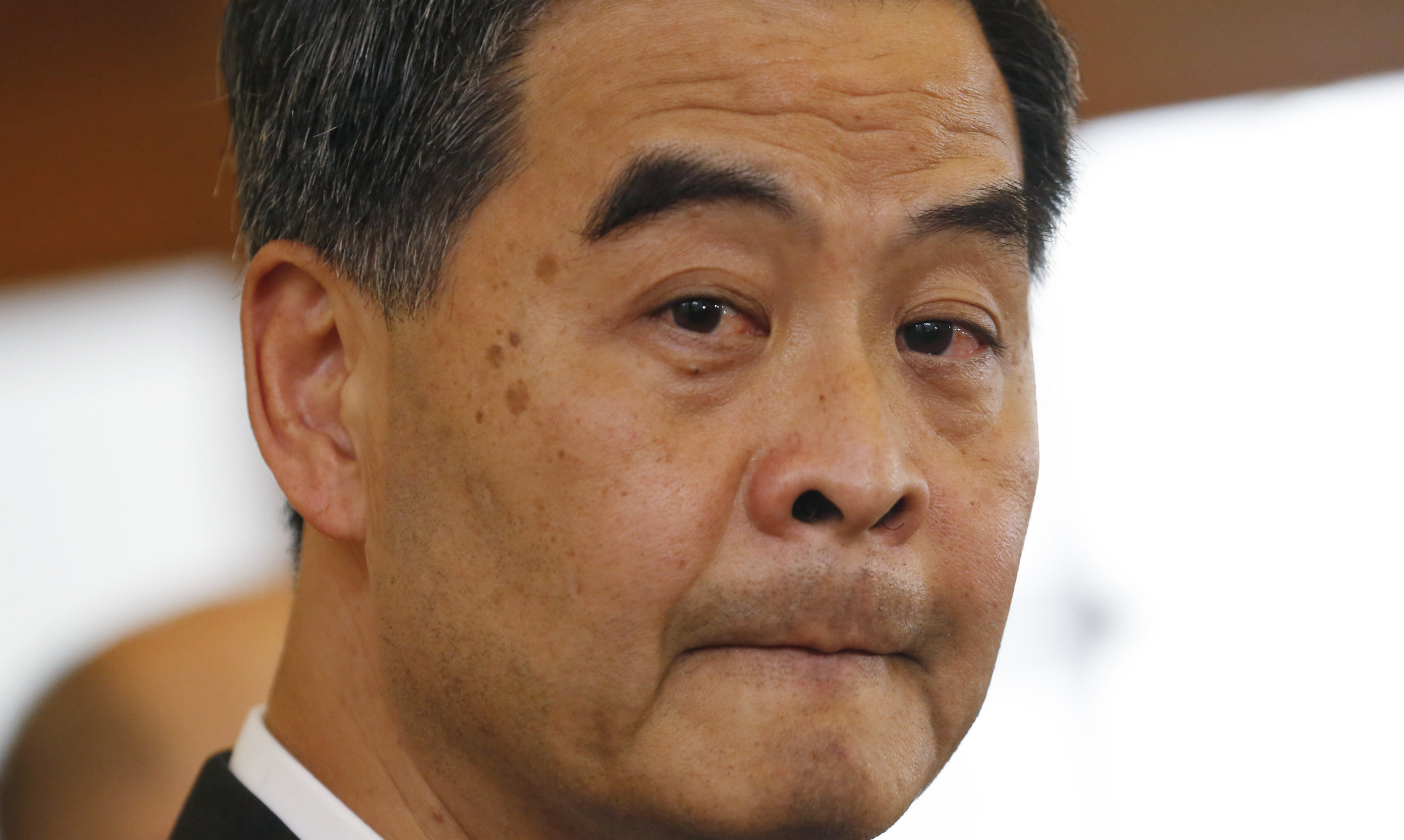 Hong Kong's chief executive, CY Leung, appears to bite his lips nervously.