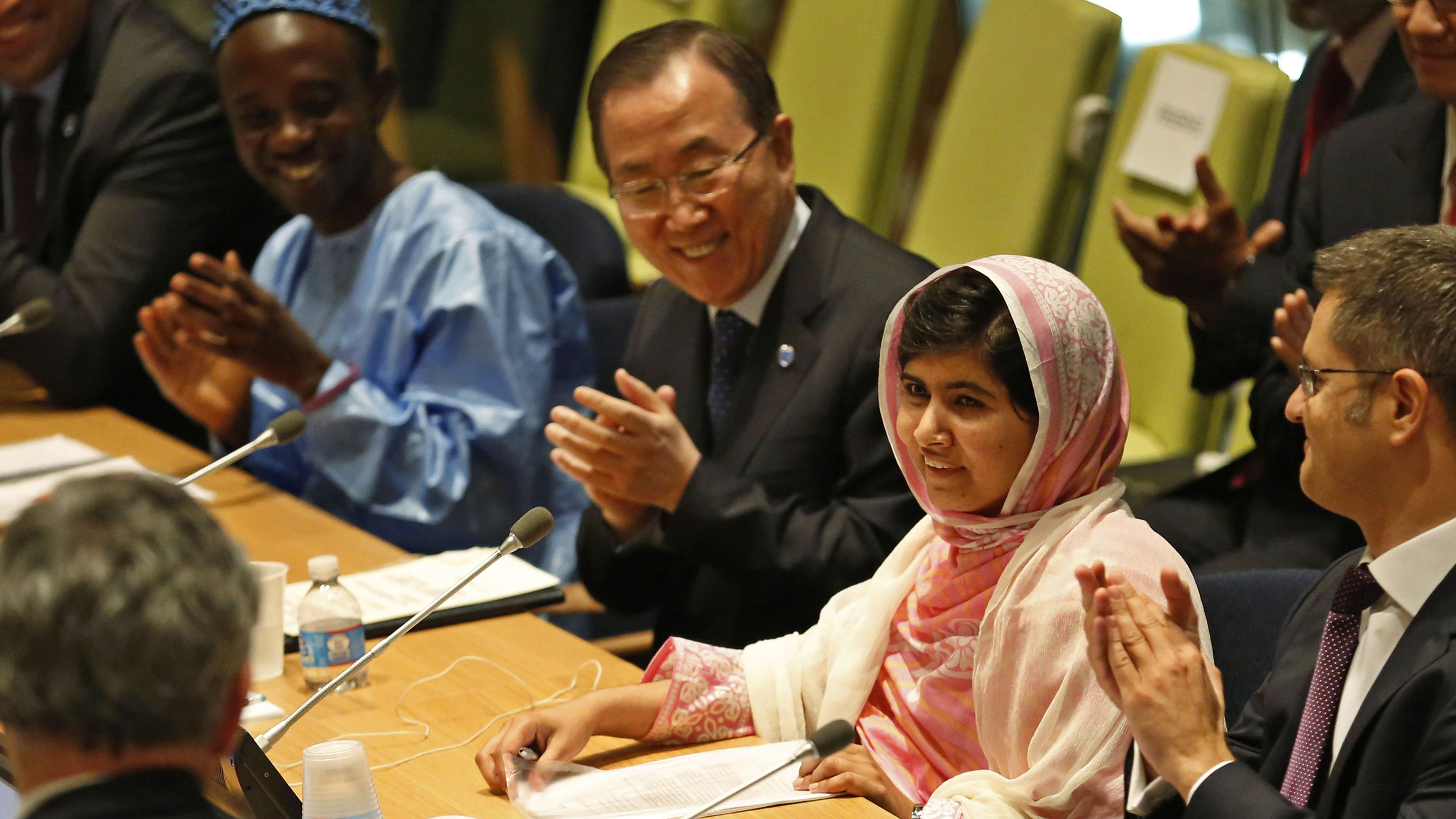 Malala Yousafzai (2nd R), is introduced before her first speech since the Taliban in Pakistan tried to kill her for advocating education for girls, at the United Nations Headquarters in New York, July 12, 2013.