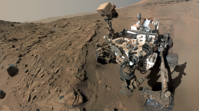 """NASA's Curiosity Mars rover used the camera at the end of its arm in April and May 2014 to take dozens of component images combined into this self-portrait where the rover drilled into a sandstone target called """"Windjana."""" The camera is the Mars Hand Lens Imager (MAHLI), which previously recorded portraits of Curiosity at two other important sites during the mission"""