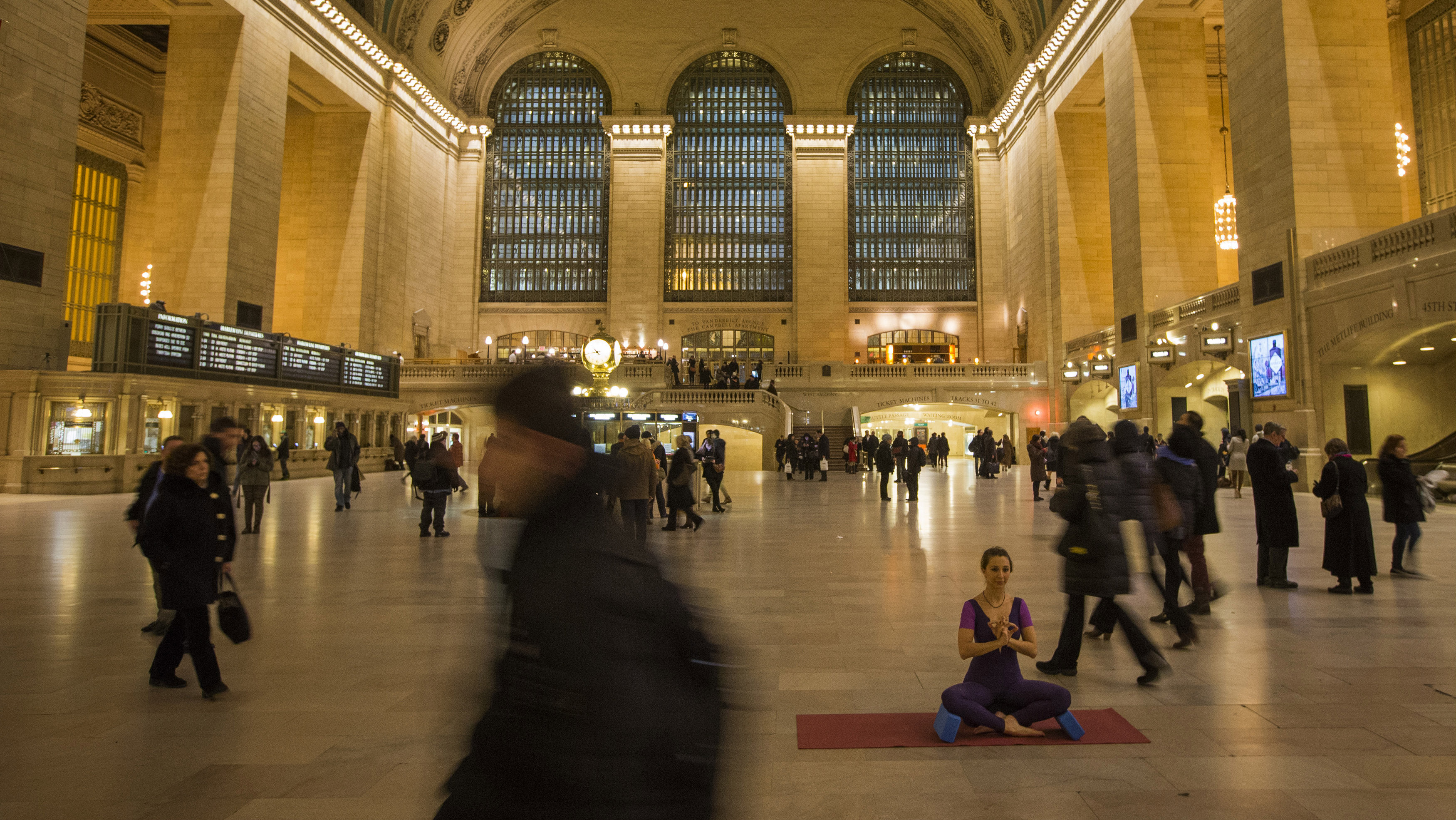 Dilek Edwards, a yoga instructor from Istanbul, Turkey who lives in New York, takes a meditative posture while posing for a friend's yoga fashion line in the main concourse of Grand Central Terminal in New York January 9, 2014.