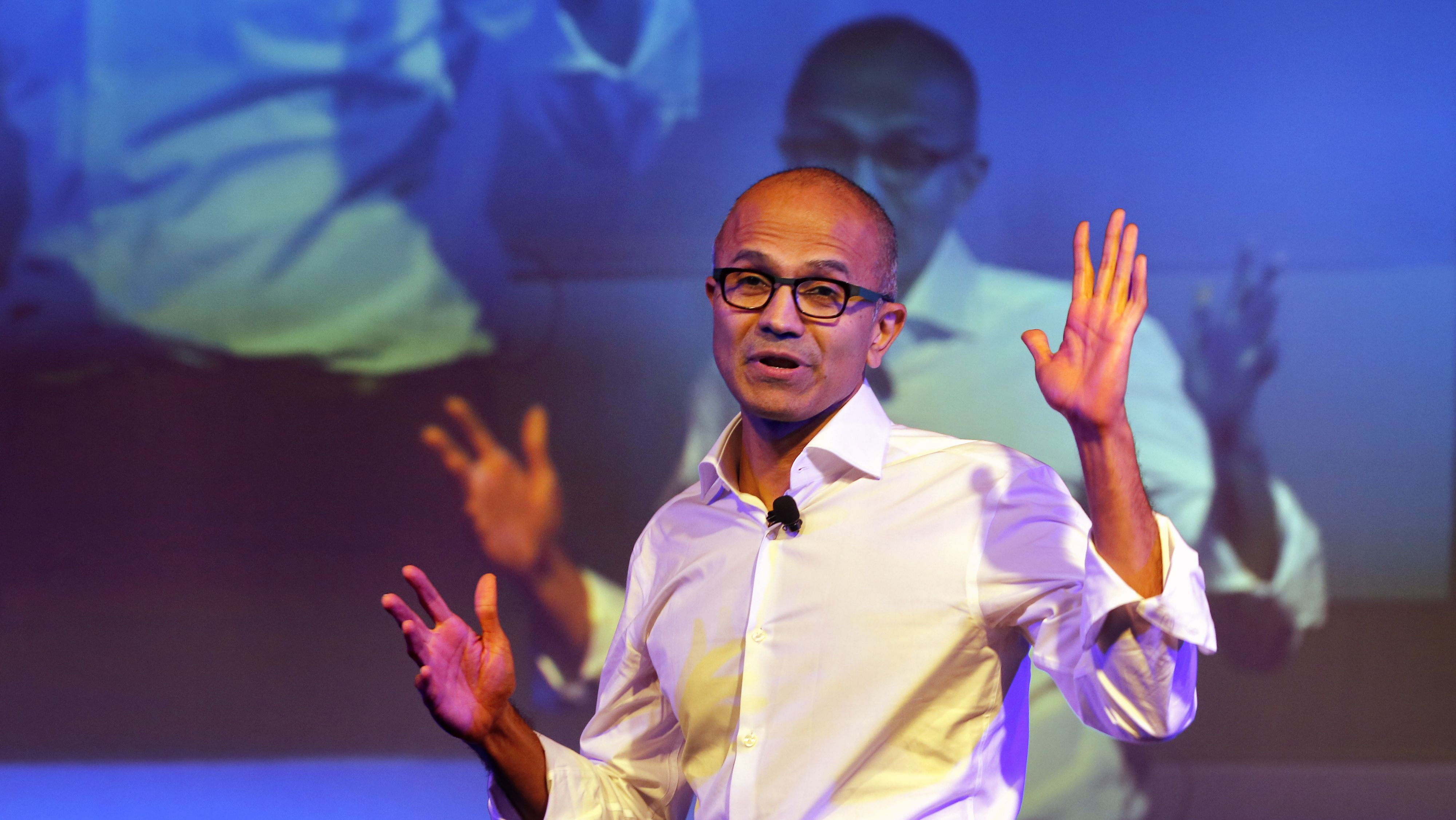 In this Tuesday, Sept. 30, 2014 file photo, Microsoft Chief Executive Officer Satya Nadella speaks to students in New Delhi. On Thursday, Oct. 9, 2014, Nadella spoke at an event for women in computing held in Phoenix, saying women don't need to ask for a raise. They should just trust the system. He was asked to give his advice to women who are uncomfortable requesting a raise. (AP Photo/Manish Swarup)