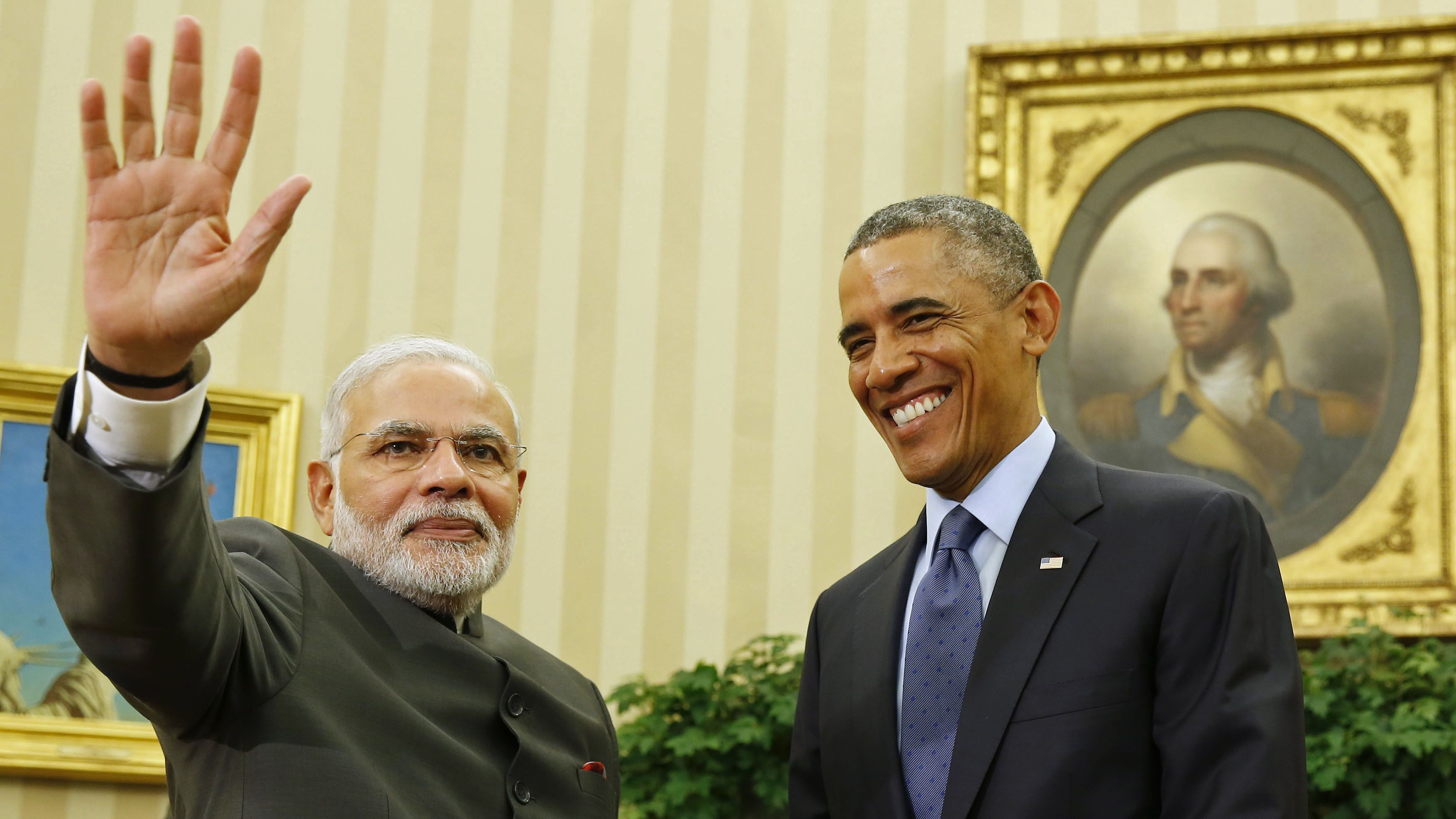 U.S. President Barack Obama smiles as he hosts a meeting with India's Prime Minister Narendra Modi in the Oval Office of the White House in Washington September 30, 2014. REUTERS/Larry Downing