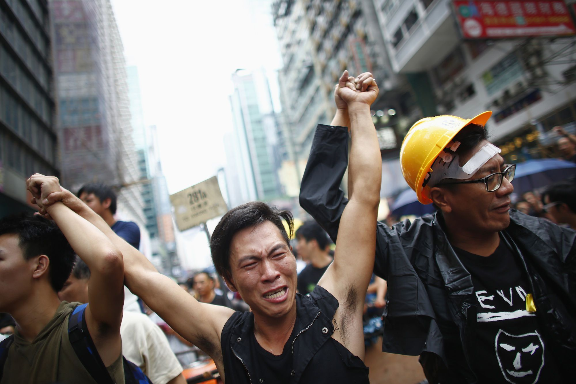 A pro-democracy protester cries after scuffles anti-protesters at a protest site in Mong Kok.