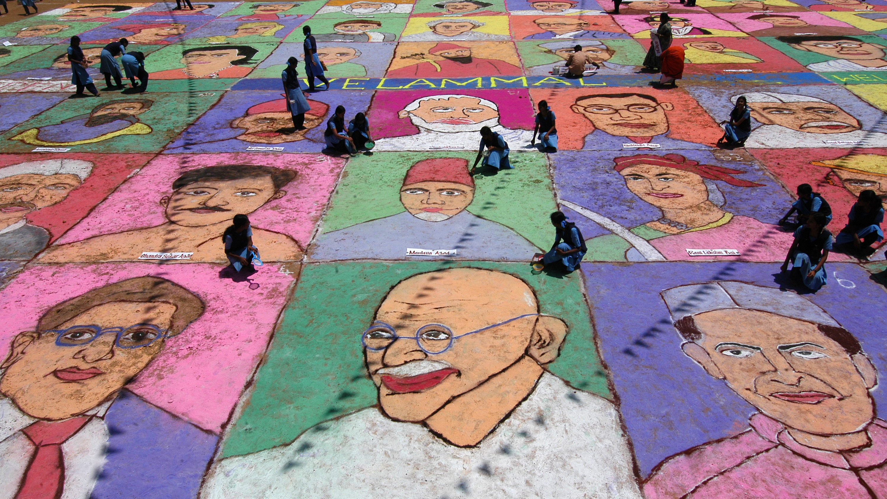 Students make a mural of 60 Indian freedom fighters as part of Independence Day celebrations at a school in the southern Indian city of Chennai August 14, 2007. 60 students gathered for two hours on Tuesday to make the 10,560 square feet painting with dry paints. India will be celebrating its 60th Independence Day on August 15, 2007.