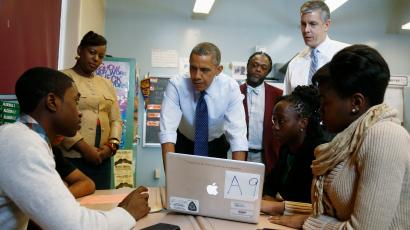President Barack Obama, accompanied by Education Secretary Arne Duncan, right, visits a math classroom at Pathways in Technology Early College High School (P-TECH) in Brooklyn borough of New York, Friday, Oct. 25, 2013, to highlight the importance of education in providing skills for American workers in a global economy. (AP Photo/Charles Dharapak)