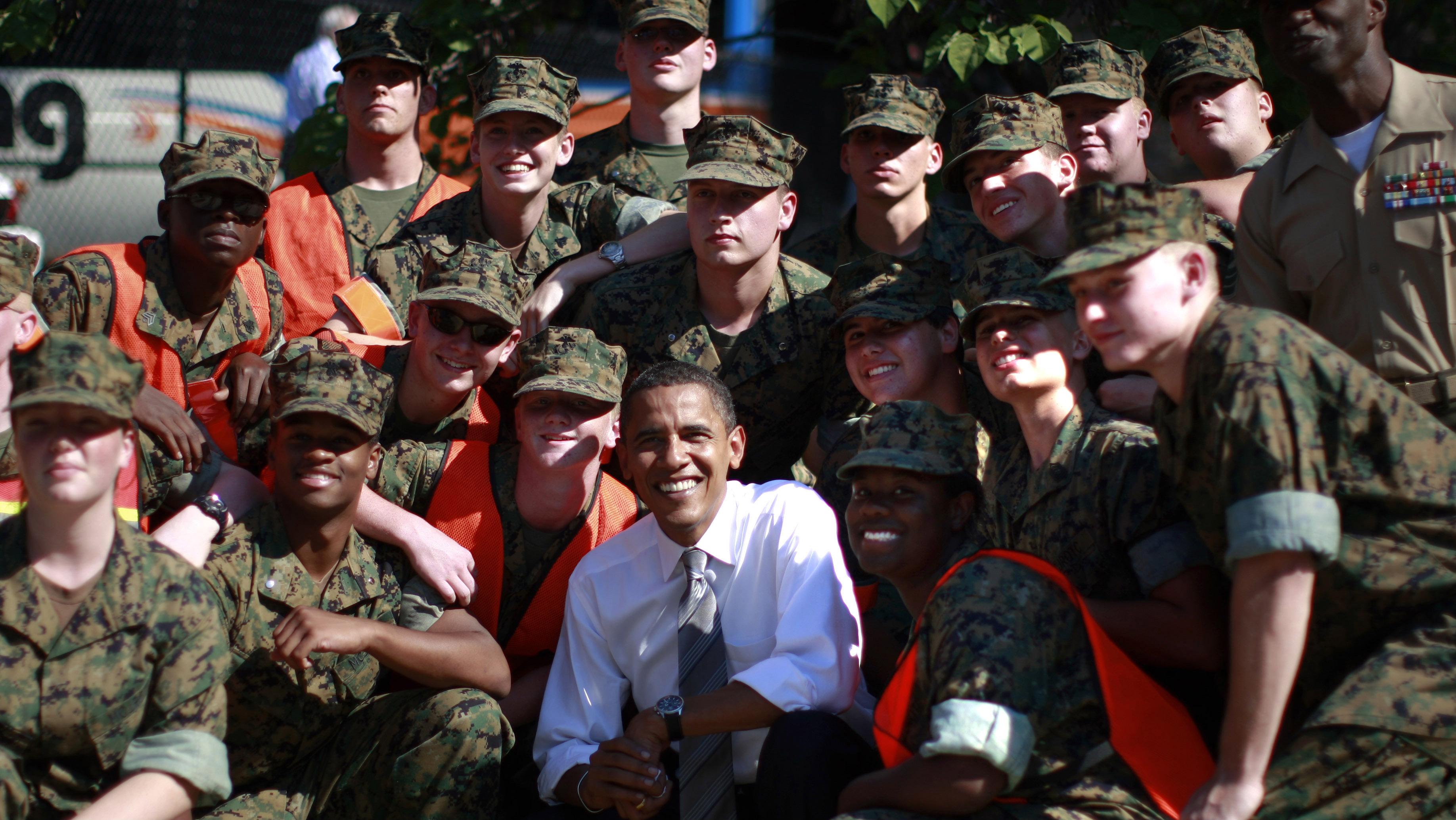 U.S. Democratic presidential nominee Senator Barack Obama (D-IL) poses with U.S. Marine Junior ROTC following a campaign rally in Asheville, North Carolina, October 5, 2008.