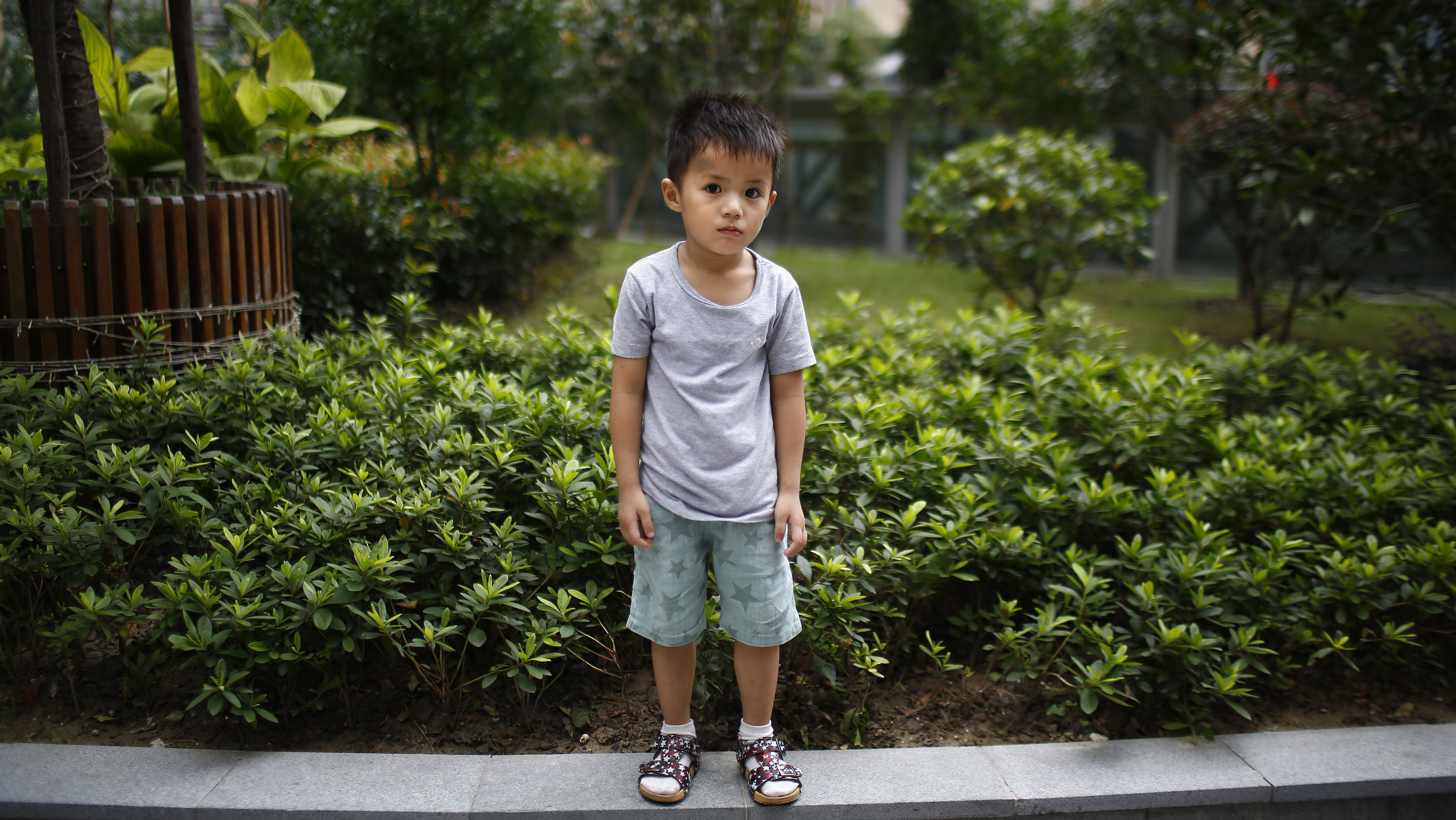 """Qin Wuyue, who was born in 2010, poses for a photograph in Shanghai August 22, 2014. When asked if he would like to have siblings, Wuyue said: """"No they're noisy."""" Reuters Photographer Carlos Barria photographed a person born in each year China?s one child policy has been in existence; from a man born in 1979, to a baby born in 2014, and asked them if they would have like to have siblings. China, the world's most populous country with nearly 1.4 billion people, says the country's one-child policy has averted 400 million births since 1980, saving scarce food resources and helping to pull families out of poverty. Couples violating the policy have had to pay a fine, or in some cases have been forced to undergo abortions. But late last year, China said it would allow millions of families to have two children, part of a plan to raise fertility rates and ease the financial burden on a rapidly ageing population. Picture taken August 22, 2014."""
