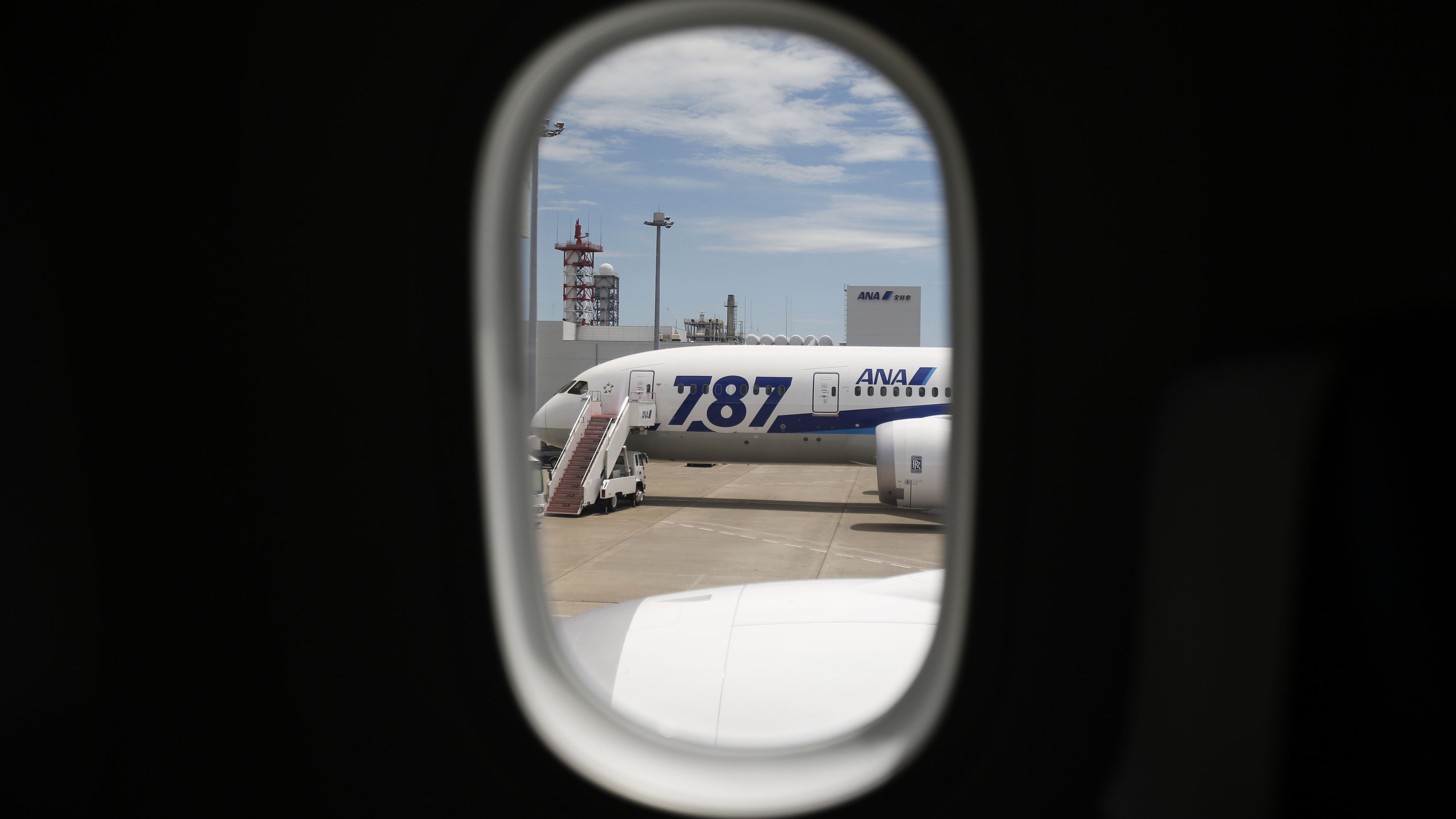An All Nippon Airways' (ANA) Boeing 787-8 Dreamliner airplane is seen through a window of a Boeing 787-9 Dreamliner during a media preview at Haneda airport in Tokyo August 4, 2014. Japanese airliner ANA will launch the world's first commercial Boeing Dreamliner 787-9 service on August 7 for domestic flights. REUTERS/Yuya Shino (JAPAN - Tags: TRANSPORT BUSINESS) - RTR414NH